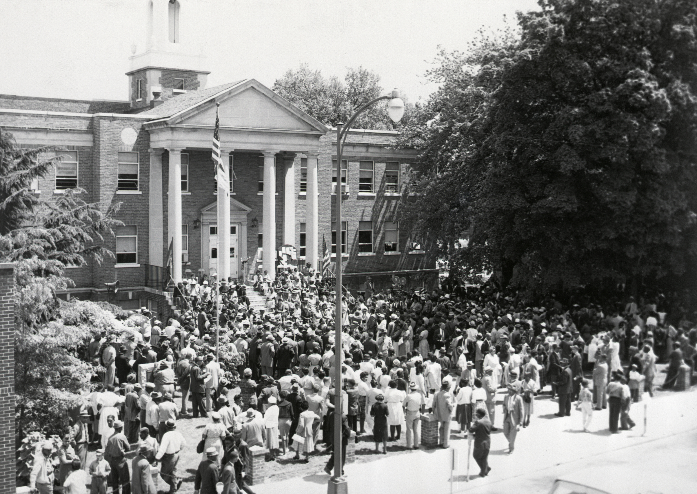 A crowd of about 1,000 attends an NAACP rally in Farmville, Va., marking the 7th anniversary of the Supreme Court's school desegregation ruling. The rally was at the courthouse of Prince Edward County, whose public schools were closed because of integration order.