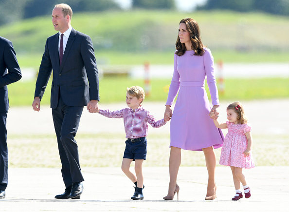 Prince William, Duke of Cambridge, Catherine, Duchess of Cambridge, Prince George of Cambridge and Princess Charlotte of Cambridge view helicopter models on July 21, 2017 in Hamburg, Germany.