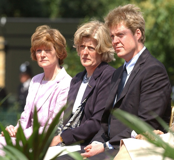 The sisters of the late Diana, Princess of Wales, Lady Sarah McCorquodale (left) and Lady Jane Fellowes, and her brother, Earl Charles Spencer, at the opening of a fountain built in memory of Diana in London's Hyde Park.