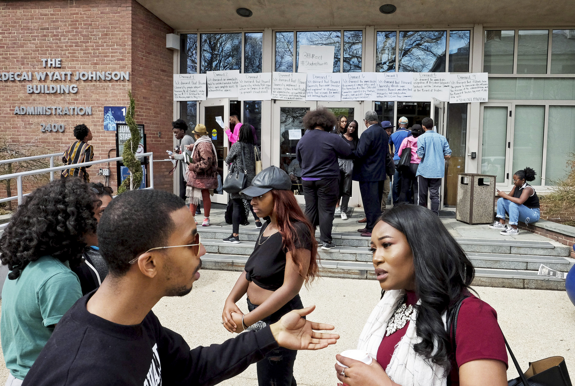 Community members talk outside a student-led sit-in at Howard University on March 30