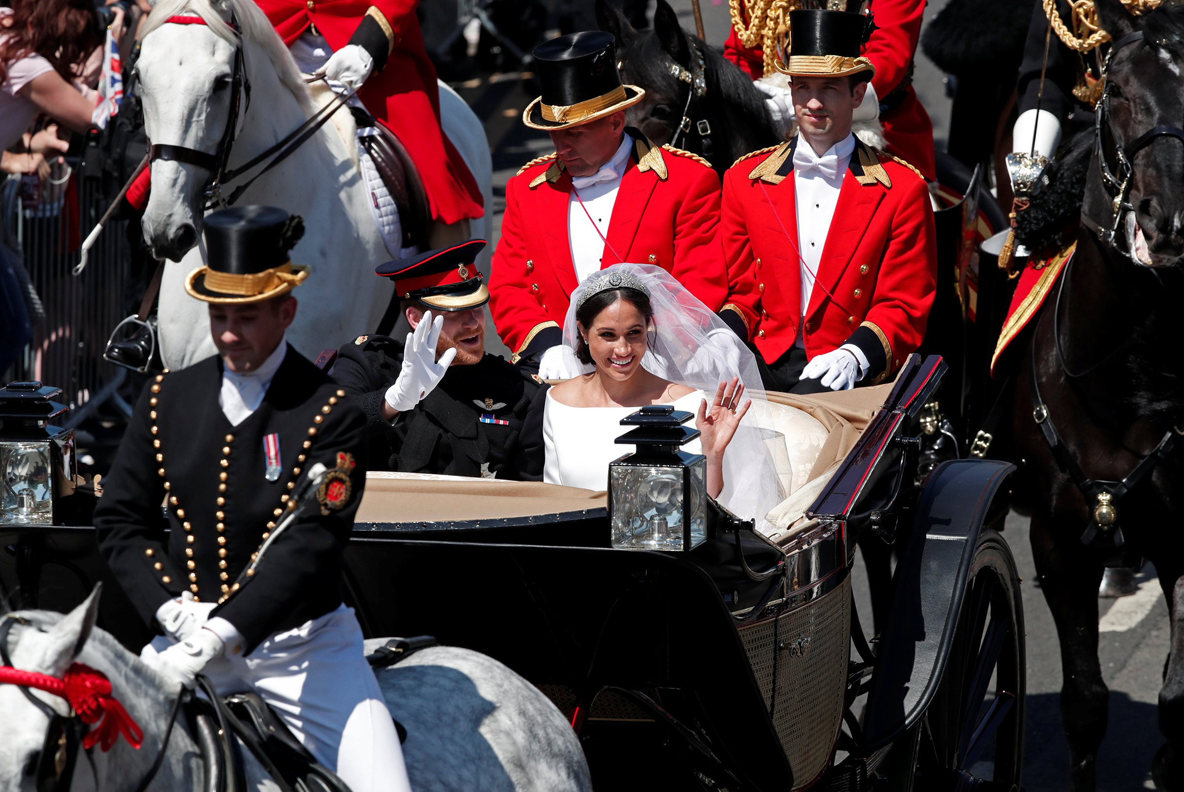 Prince Harry and Meghan Markle in a horse-drawn carriage after their wedding ceremony at St George's Chapel in Windsor Castle, May 19, 2018.