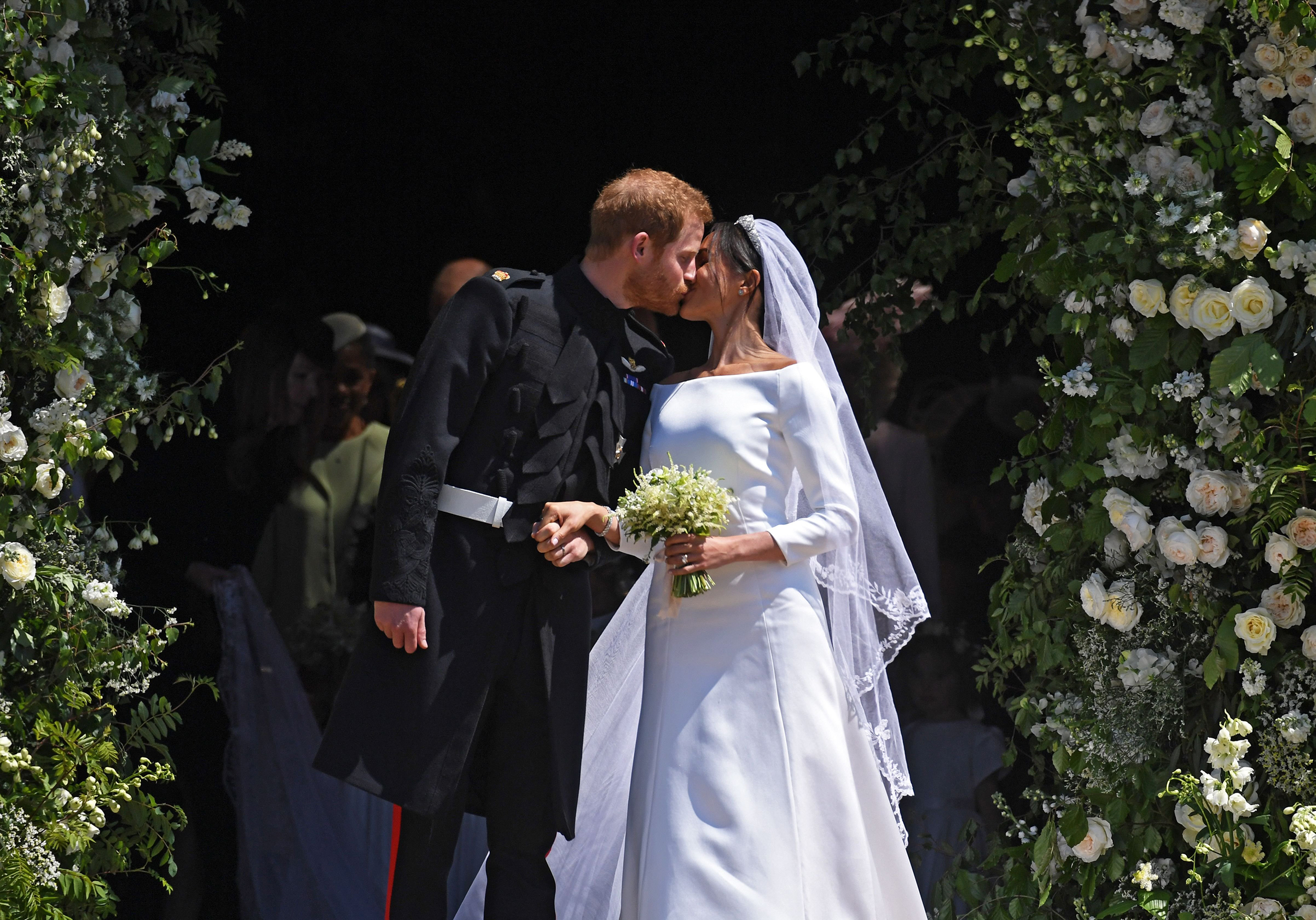 The newlyweds exchange a much-anticipated kiss as they exit the chapel.