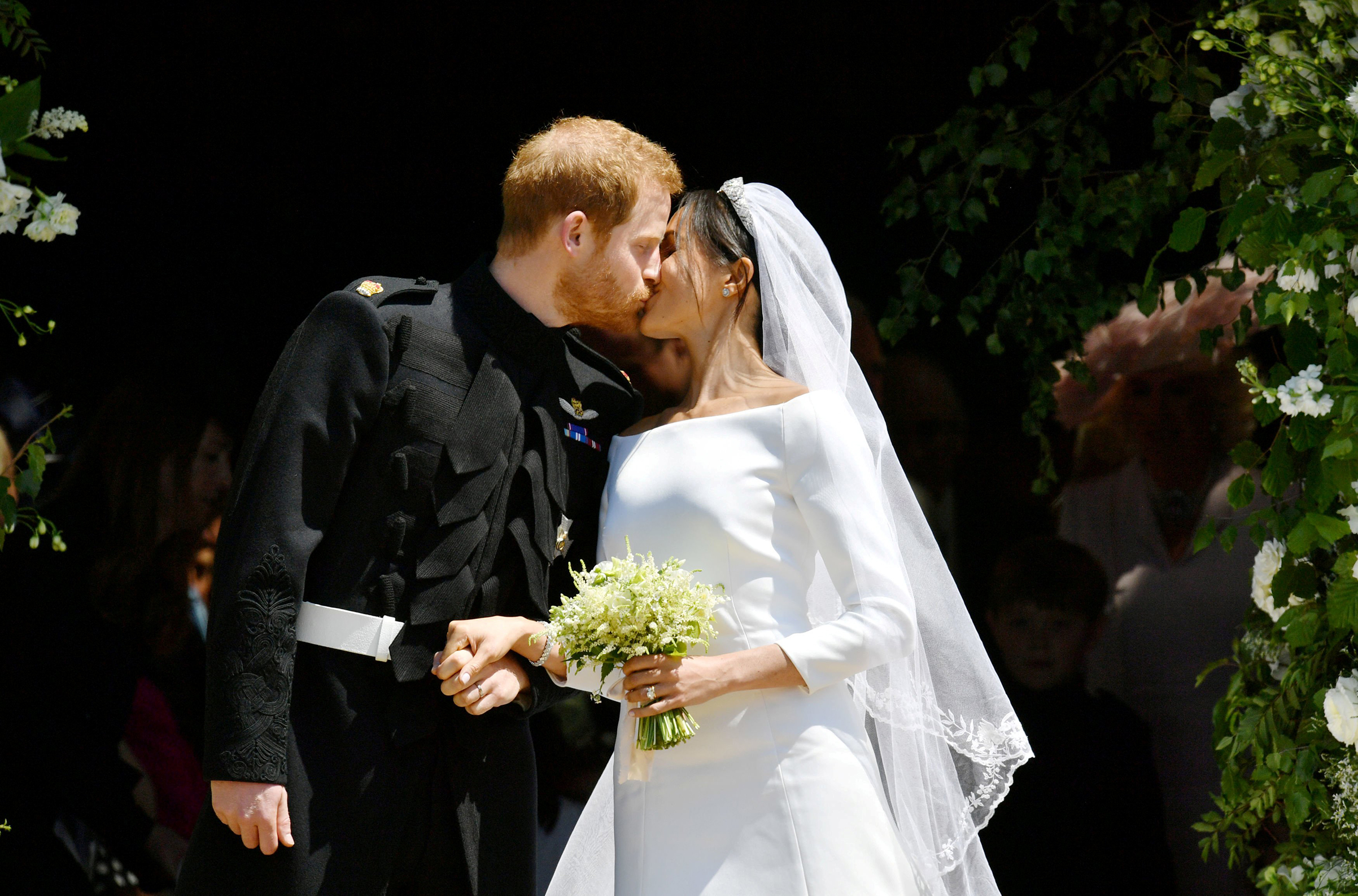 Prince Harry and Meghan Markle kiss on the steps of St George's Chapel in Windsor Castle after their wedding, May 19, 2018.