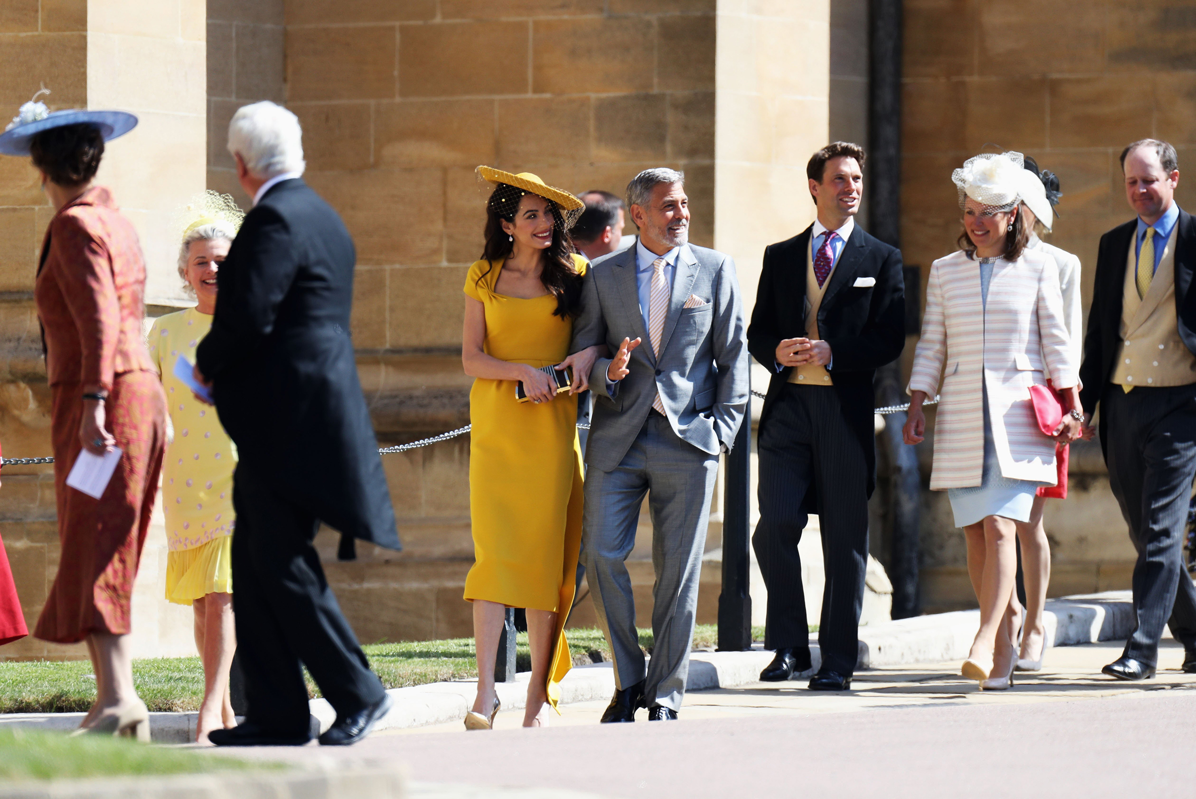 Amal Clooney and George Clooney arrive at the wedding of Prince Harry to Ms Meghan Markle at St George's Chapel, Windsor Castle on May 19, 2018 in Windsor, England.