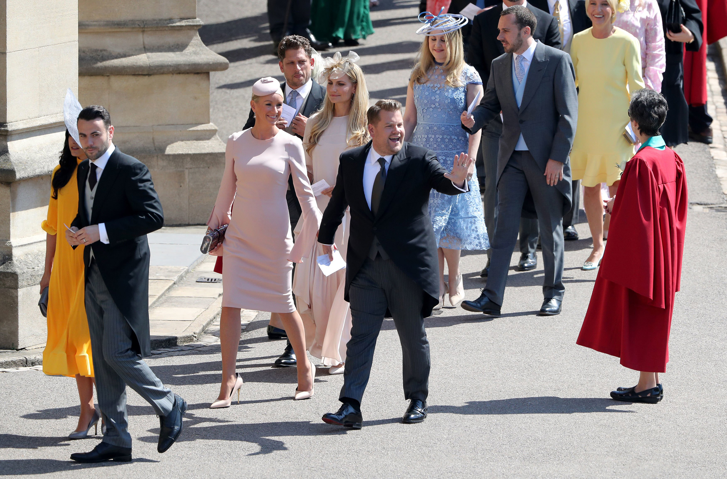 James Corden and Julia Carey arrive for the wedding ceremony of Britain's Prince Harry, Duke of Sussex and Meghan Markle at St George's Chapel, Windsor Castle, in Windsor, on May 19, 2018.
