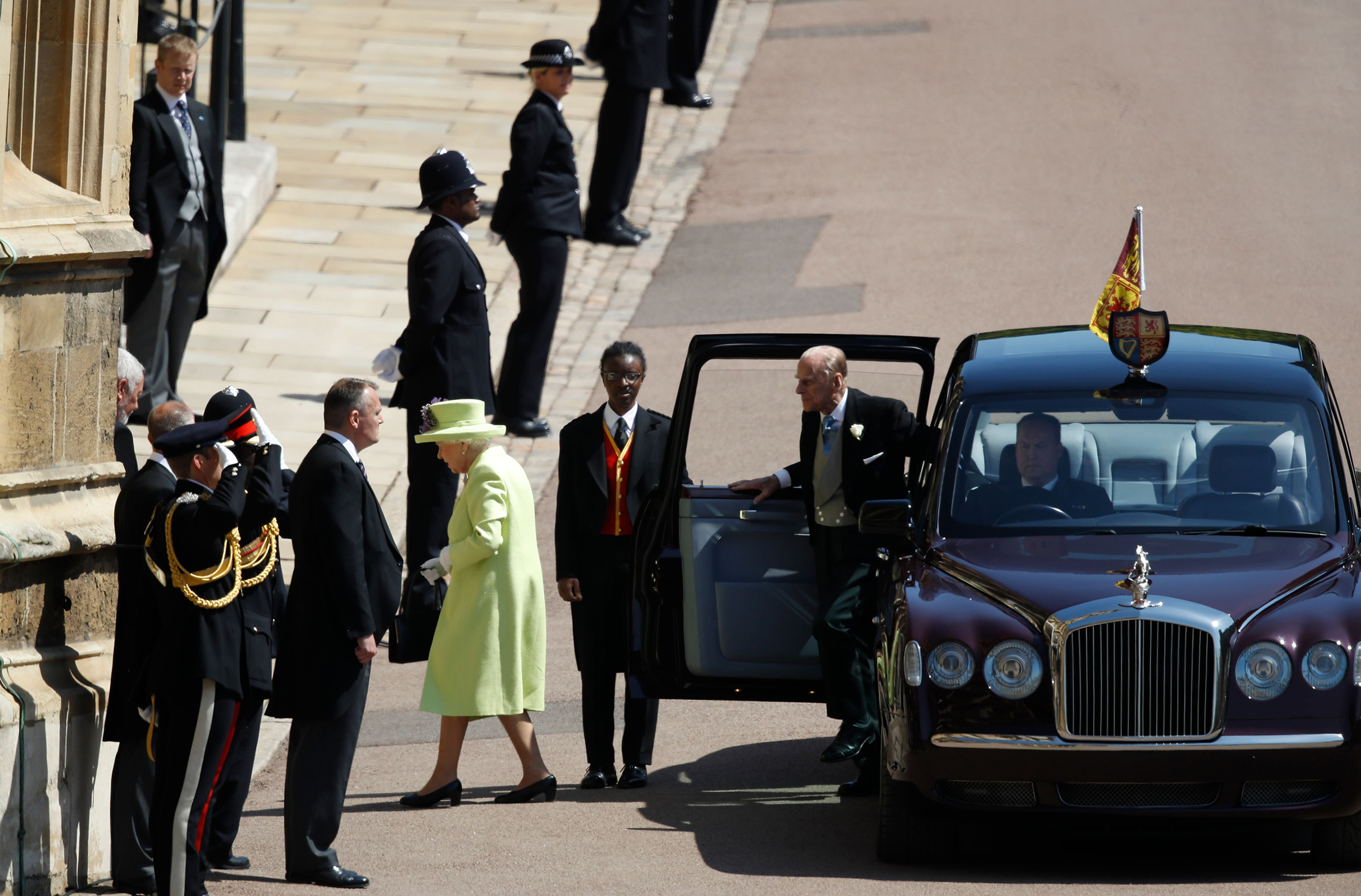 Queen Elizabeth II and Prince Philip, Duke of Edinburgh, arrive at St George's Chapel.