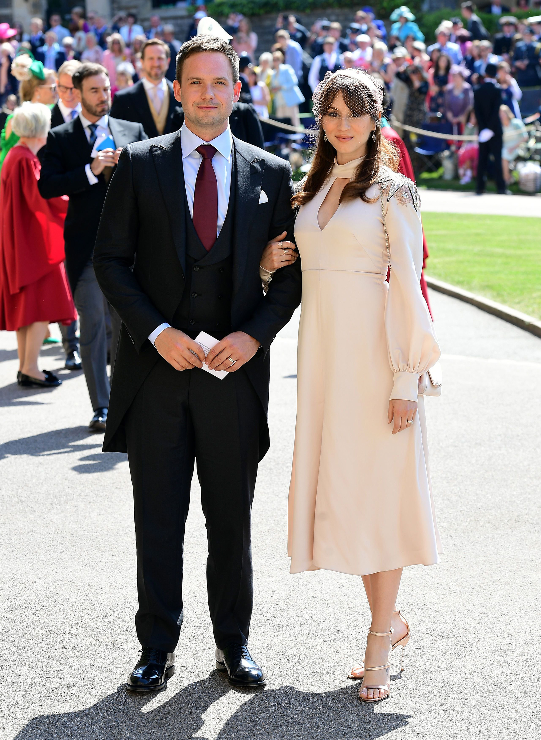 Patrick J. Adams and Troian Bellisario arrive for the wedding ceremony of Prince Harry, Duke of Sussex and Meghan Markle at St George's Chapel, Windsor Castle, in Windsor, on May 19, 2018.