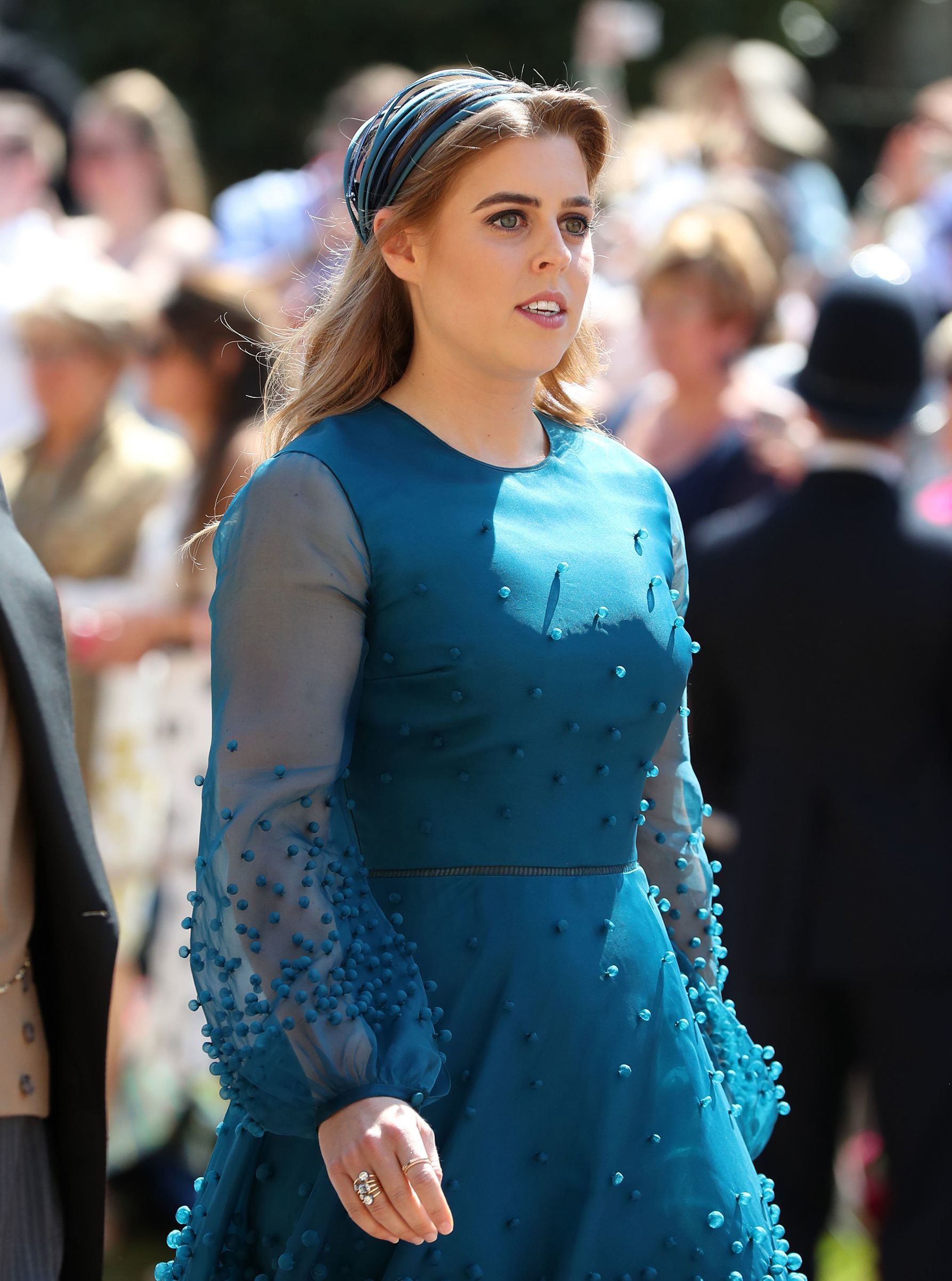 Princess Beatrice arrives at St George's Chapel at Windsor Castle before the wedding of Prince Harry to Meghan Markle on May 19, 2018.