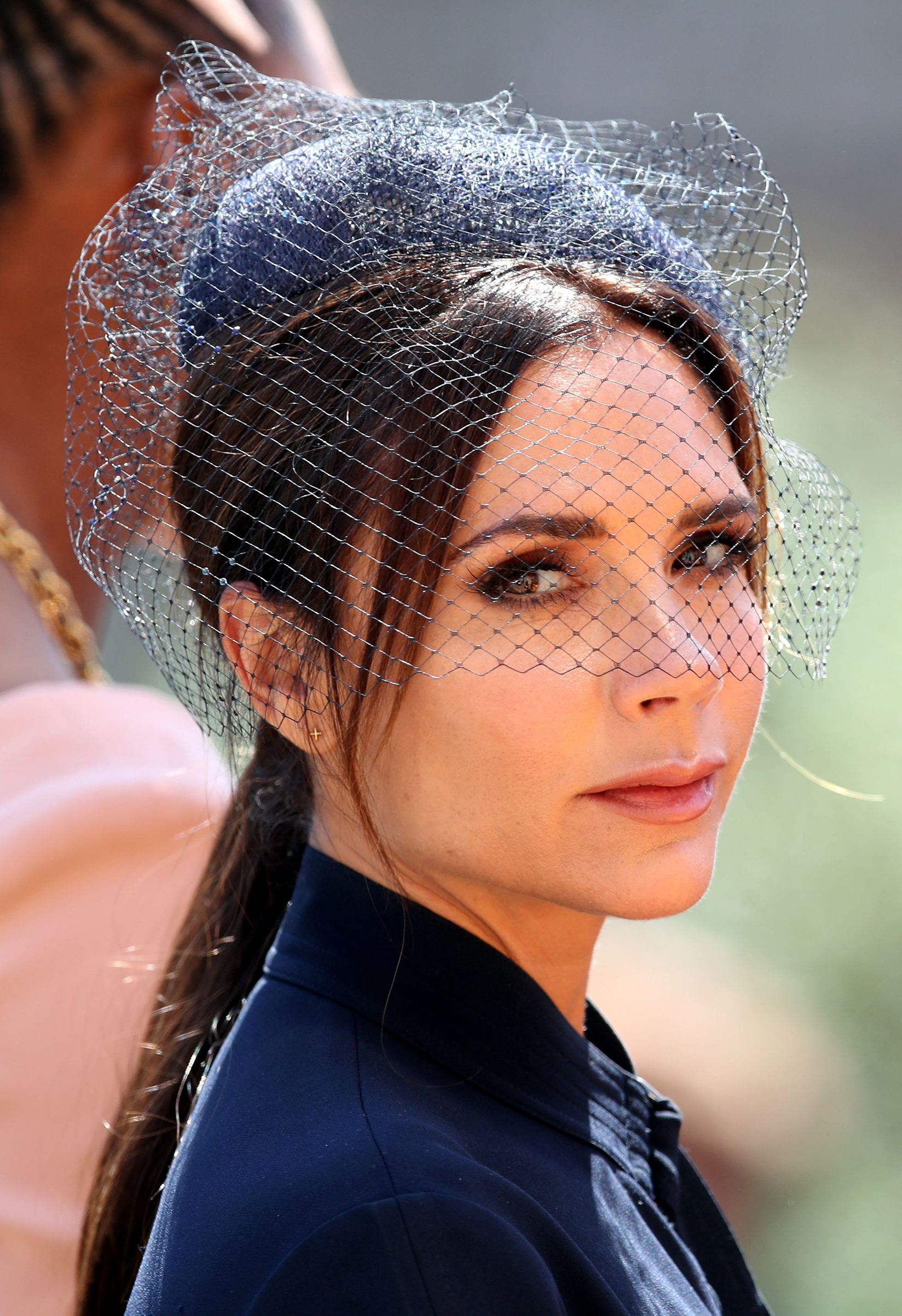 Victoria Beckham leaves St George's Chapel at Windsor Castle after the wedding of Meghan Markle and Prince Harry, May 19, 2018.