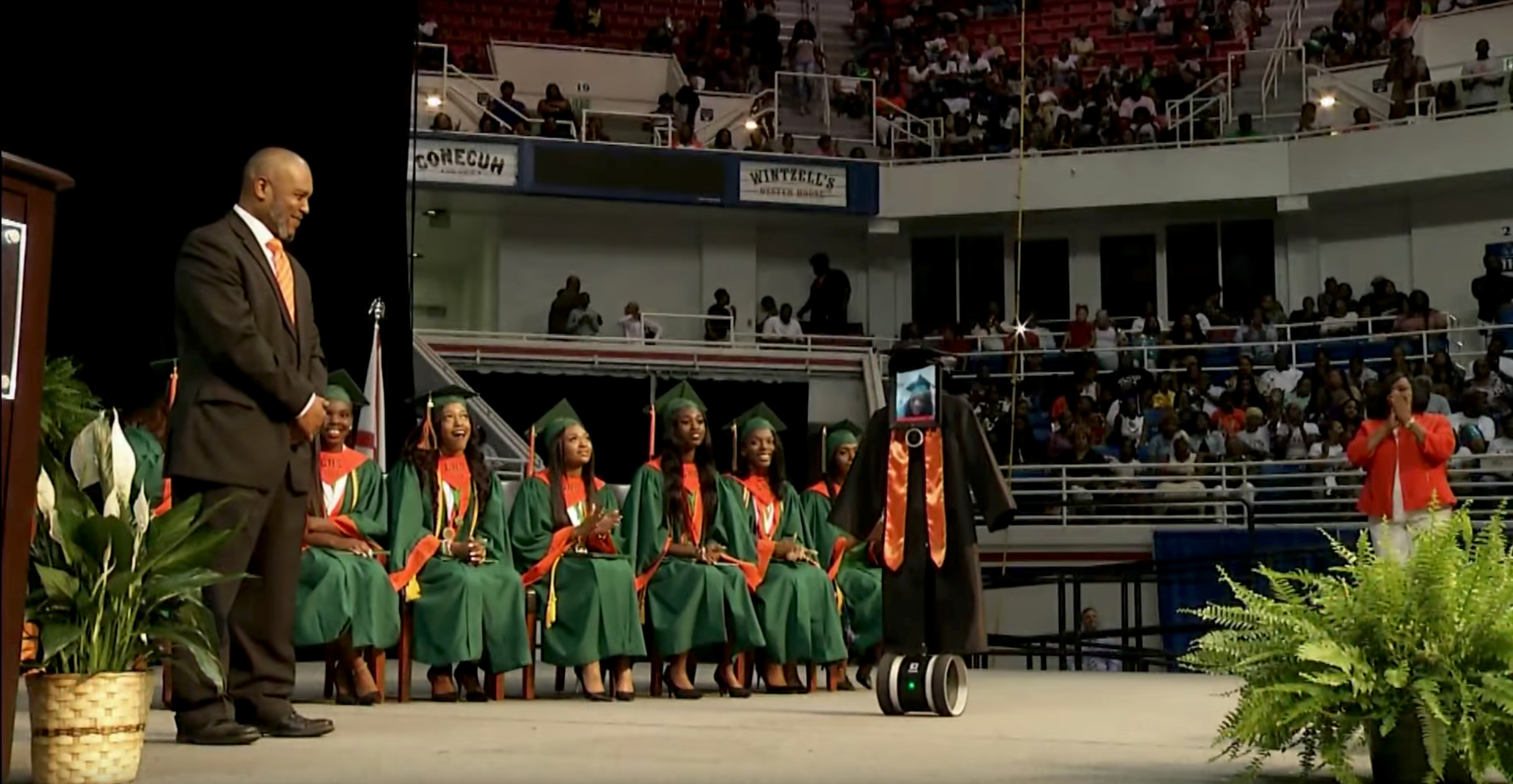 A robot bearing an iPad 'received' high school diploma for student Cynthia Pettway, who was unable to leave a hospital, in Mobile, Alabama on May 14, 2018.