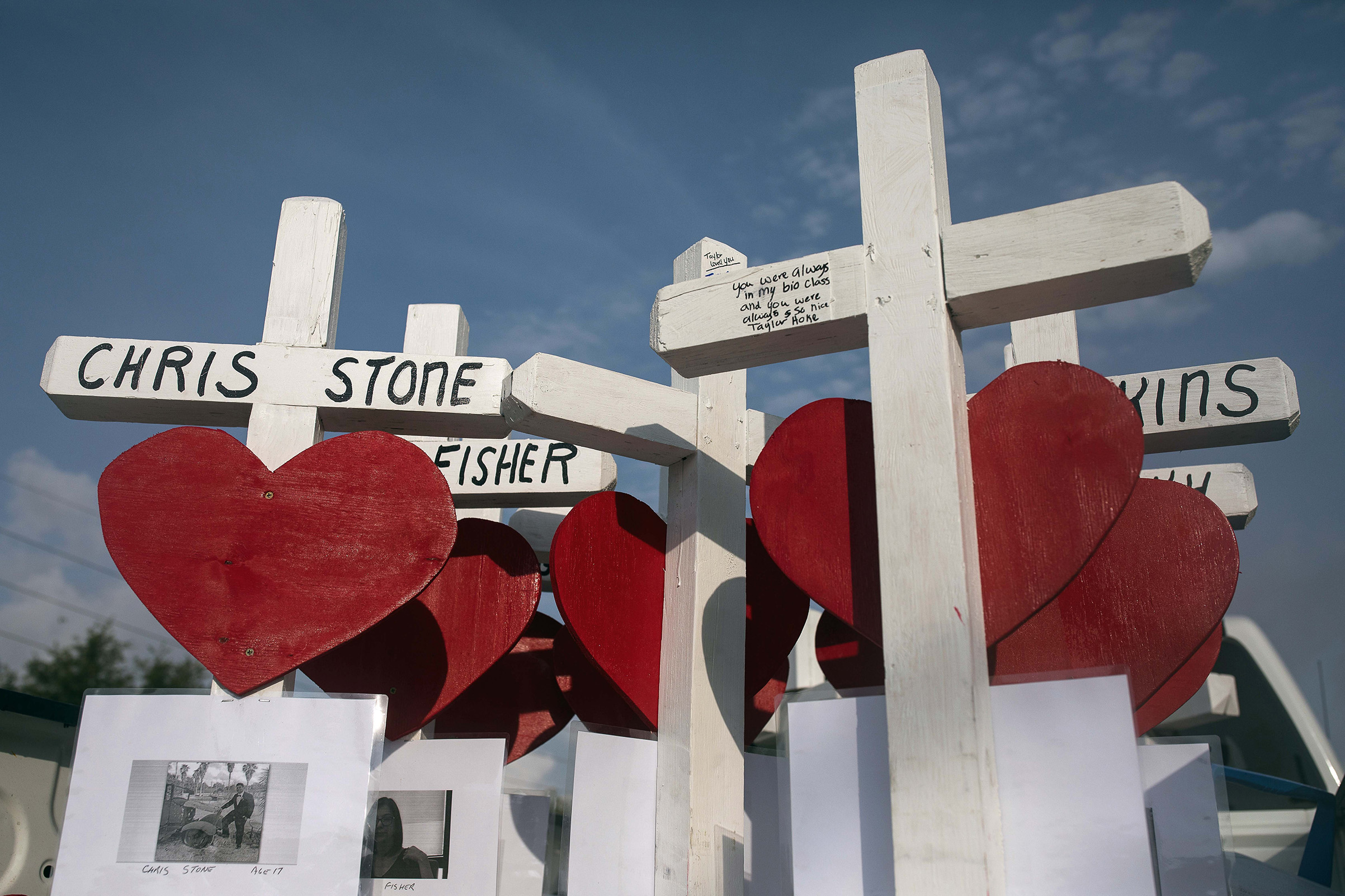 Ten crosses with the names of the Santa Fe High School shooting victims sits in the bed of a truck outside the school on May 21, 2018.