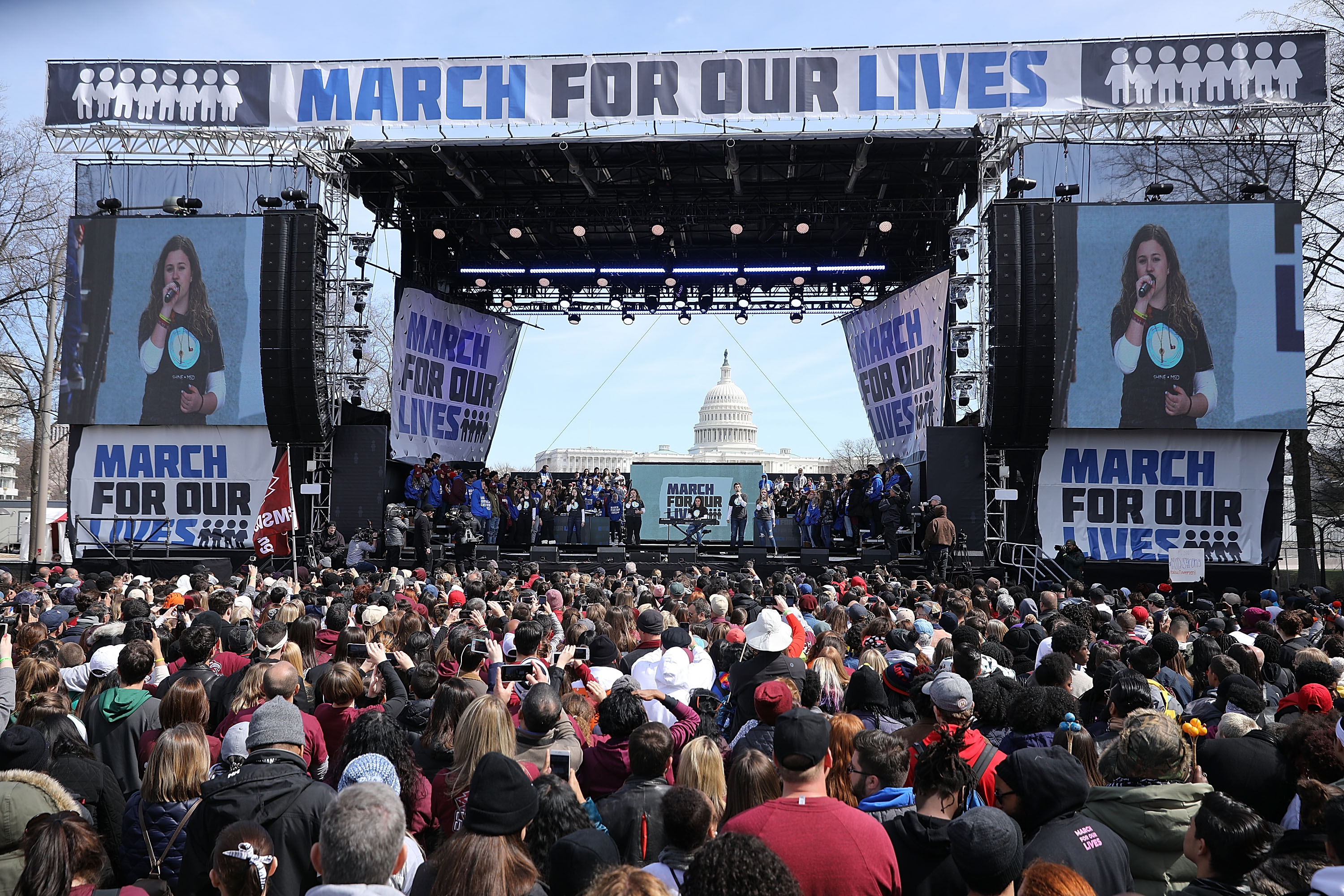 Marjory Stoneman Douglas High School drama club and choir members perform  Shine  during the March for Our Lives rally on March 24, 2018 in Washington, DC. Hundreds of thousands of demonstrators, including students, teachers and parents gathered in Washington for the anti-gun violence rally organized by survivors of the Marjory Stoneman Douglas High School school shooting on February 14 that left 17 dead. More than 800 related events are taking place around the world to call for legislative action to address school safety and gun violence.