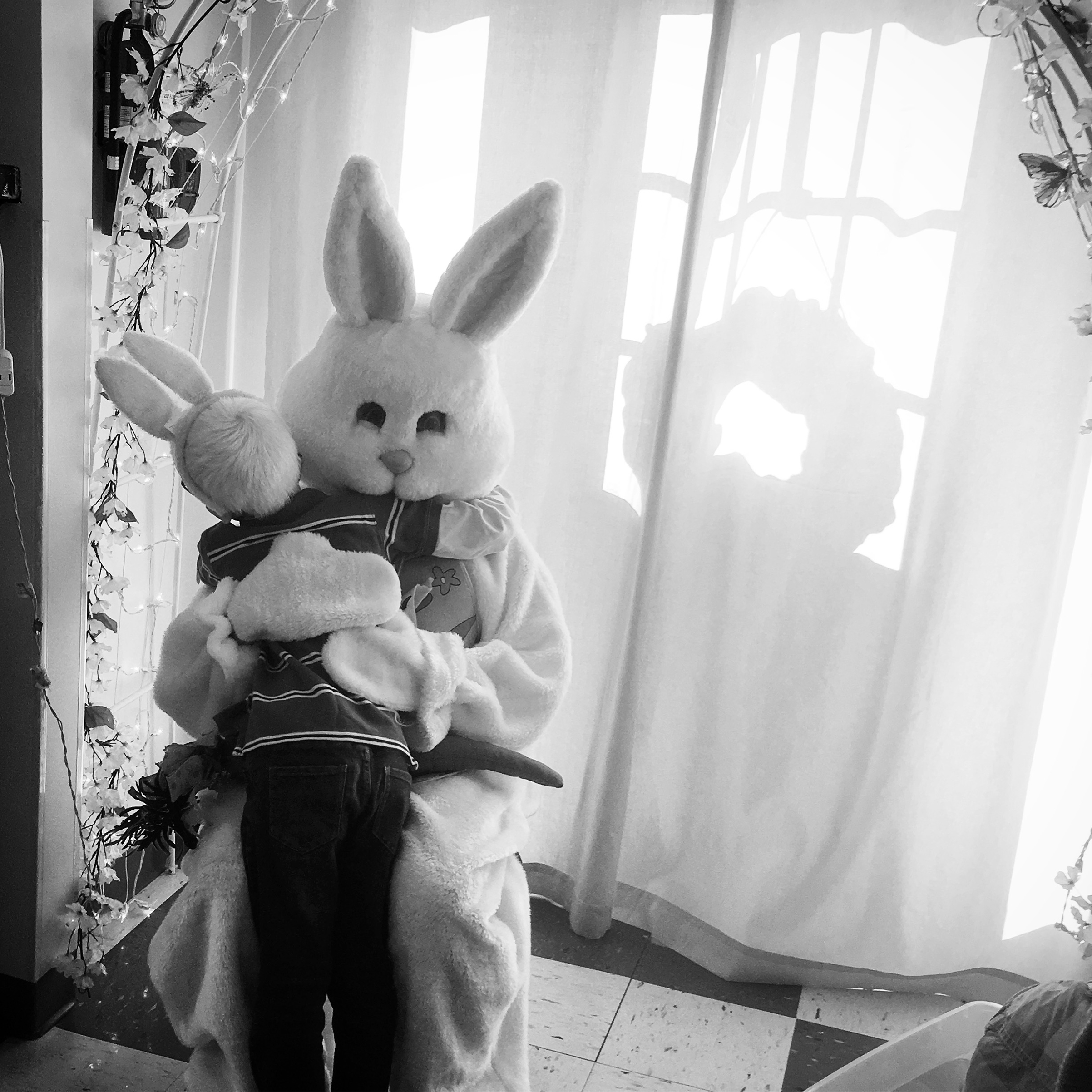 Forest rushes to the front of the line at his sister's preschool to give a hug to the Easter Bunny.