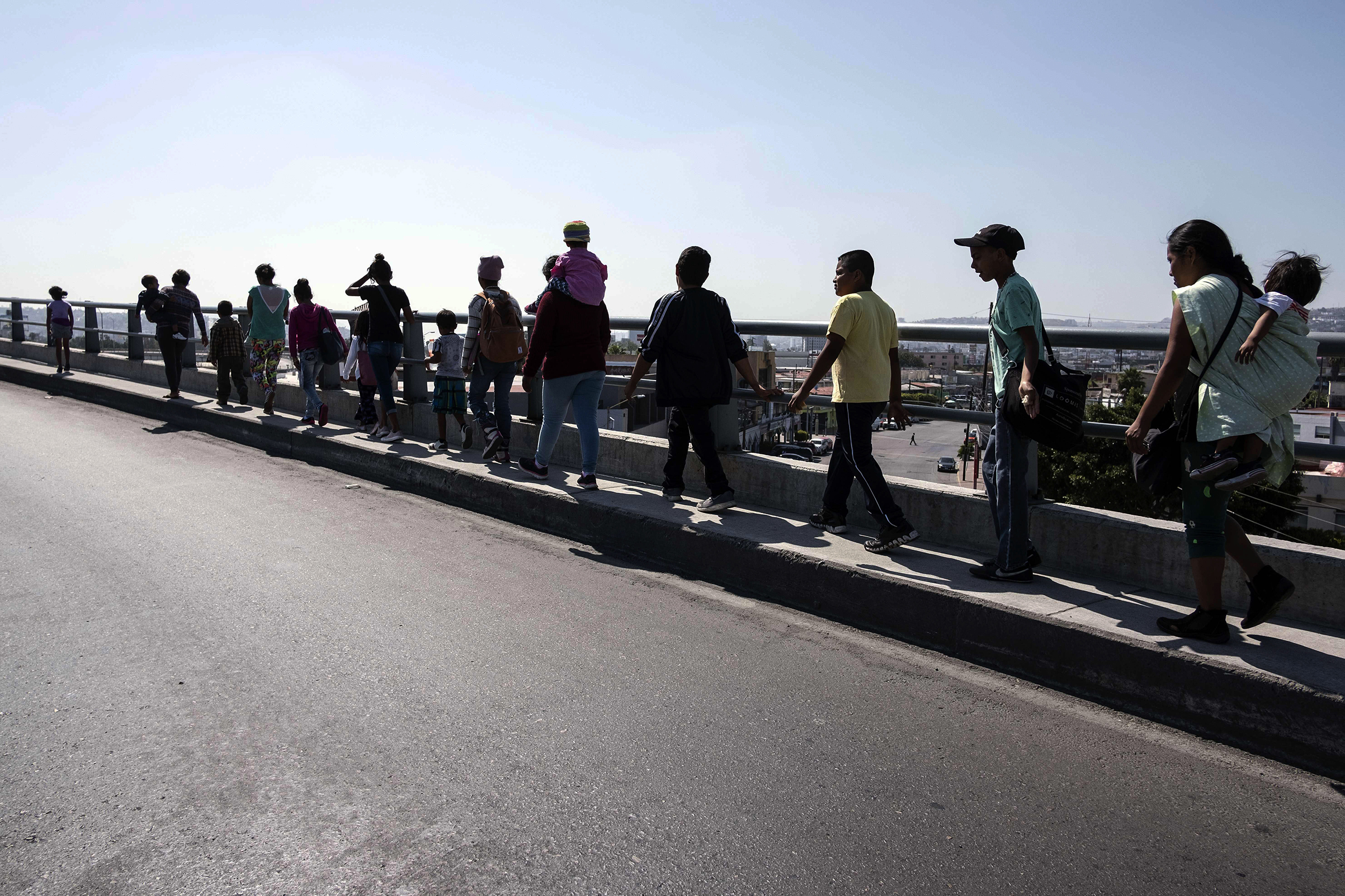 Central American migrants travelling in the  Migrant Via Crucis  caravan walk to their legal counselling meeting in Tijuana, Baja California state, Mexico, on April 28, 2018