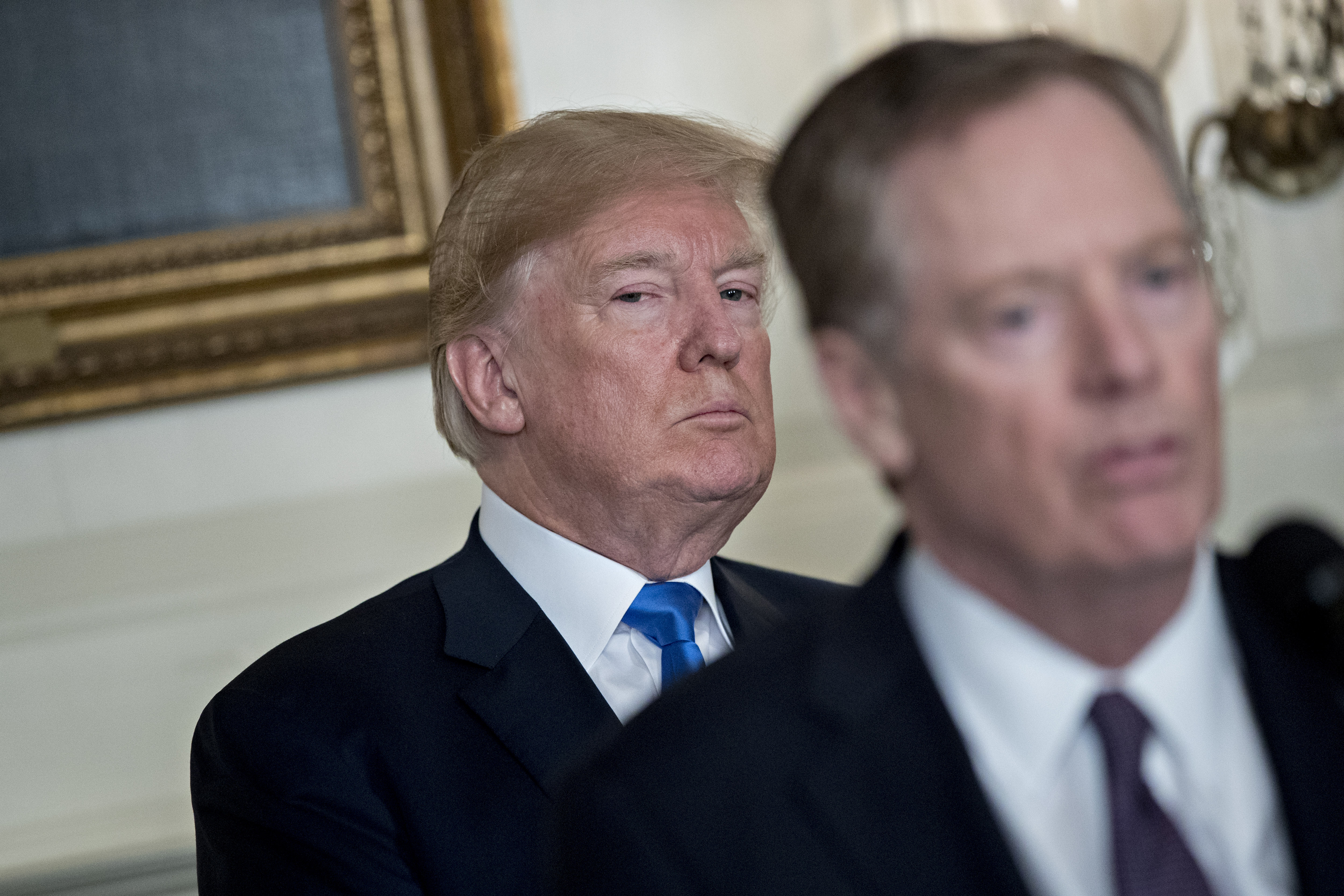 U.S. President Donald Trump listens as Robert Lighthizer, U.S. trade representative, right, speaks before Trump signs a presidential memorandum targeting China's economic aggression in the Diplomatic Room of the White House in Washington, D.C. on March 22