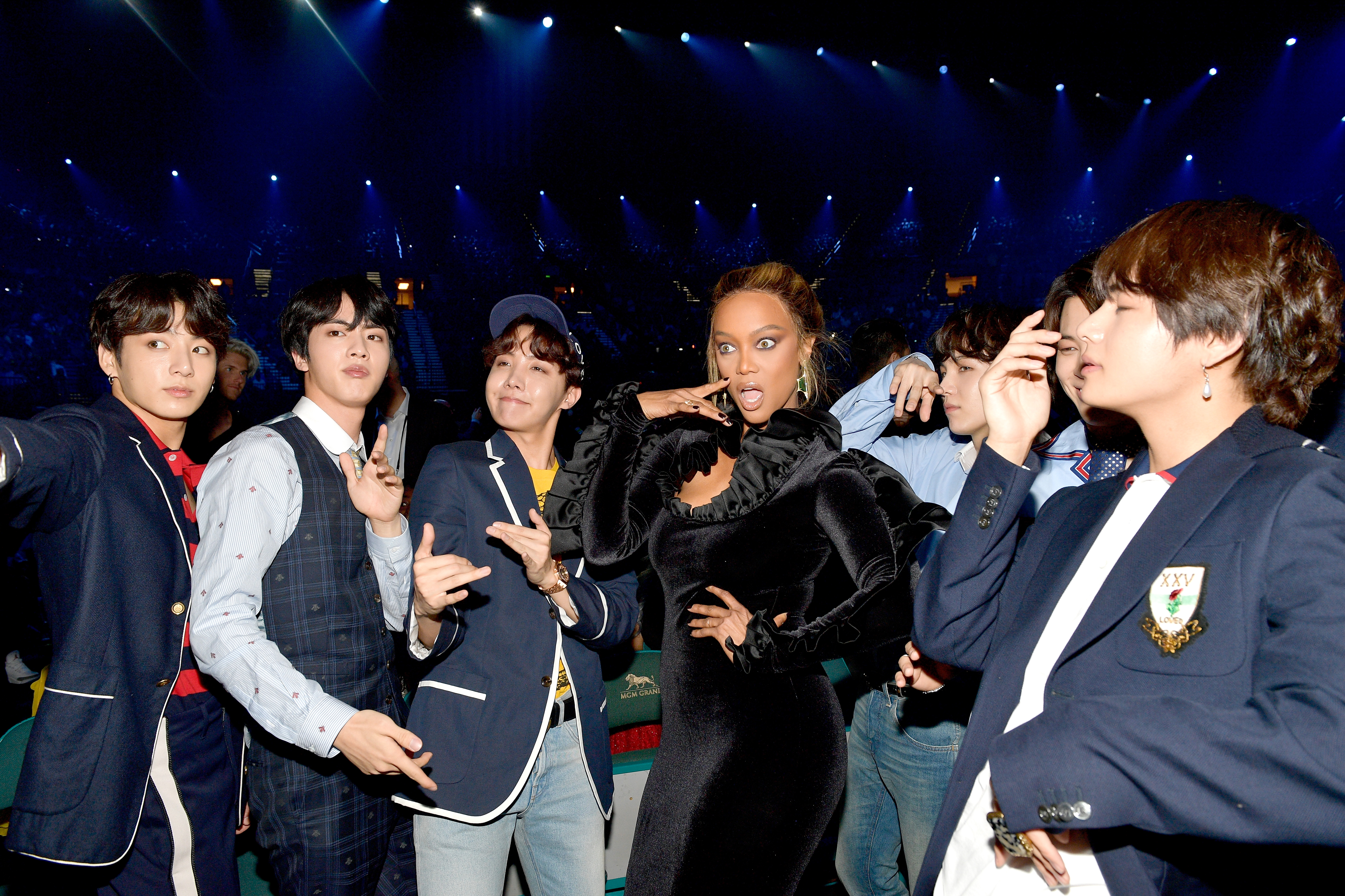 Model Tyra Banks with musical group BTS attend the 2018 Billboard Music Awards at MGM Grand Garden Arena on May 20, 2018 in Las Vegas, Nevada.