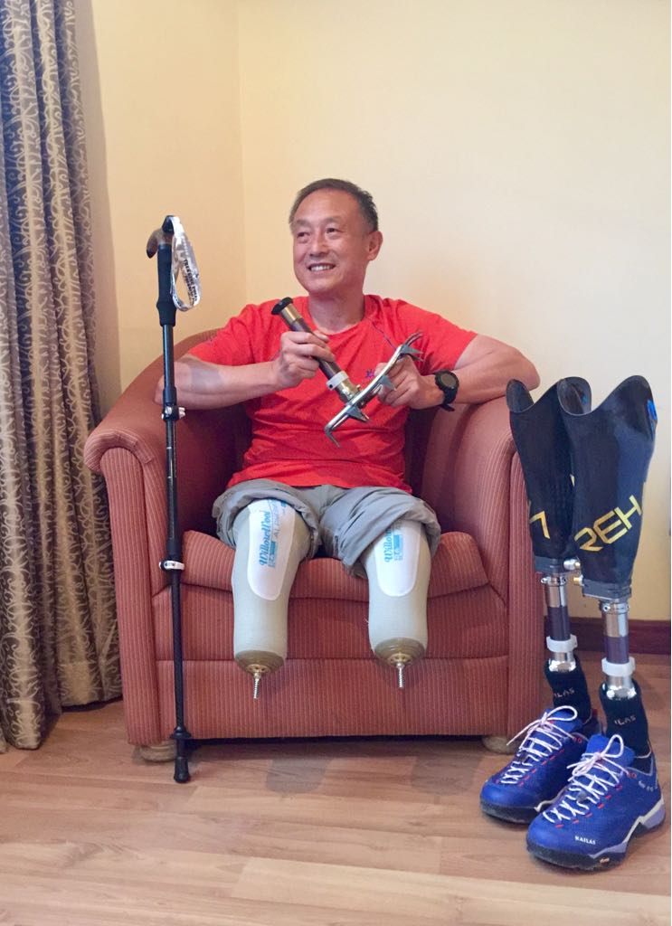 Xia Boyu, a 69 year-old double amputee from China, sitting in his hotel room in Kathmandu prior to his fifth attempt to summit Mount Everest, on April 4, 2018.