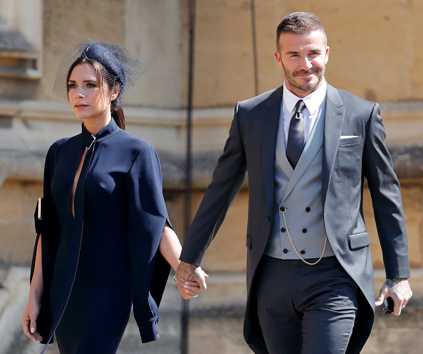 Victoria Beckham and David Beckham attend the wedding of Prince Harry to Ms Meghan Markle at St George's Chapel, Windsor Castle on May 19, 2018 in Windsor, England.
