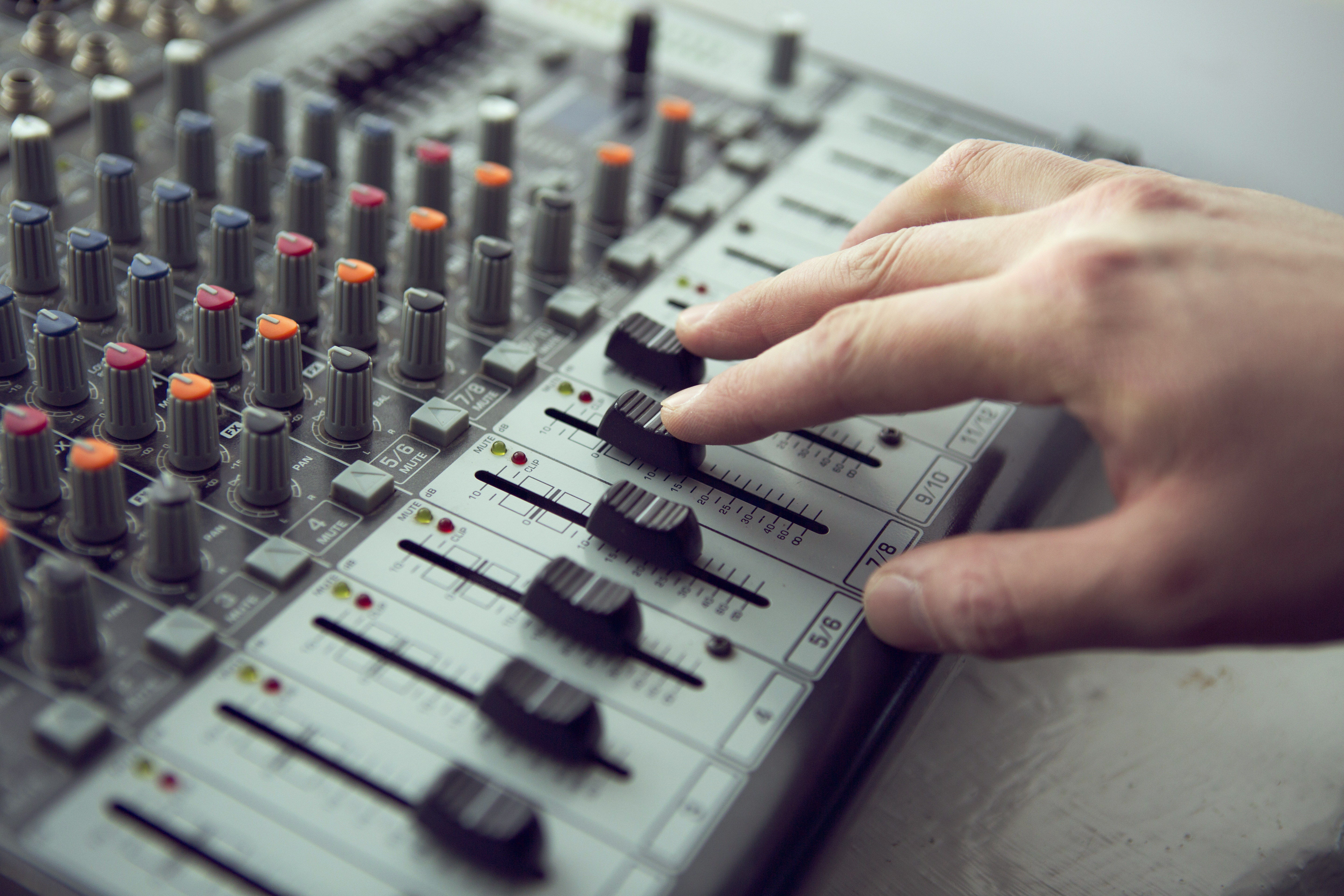 An expert adjusting audio mixing console. Music Studio