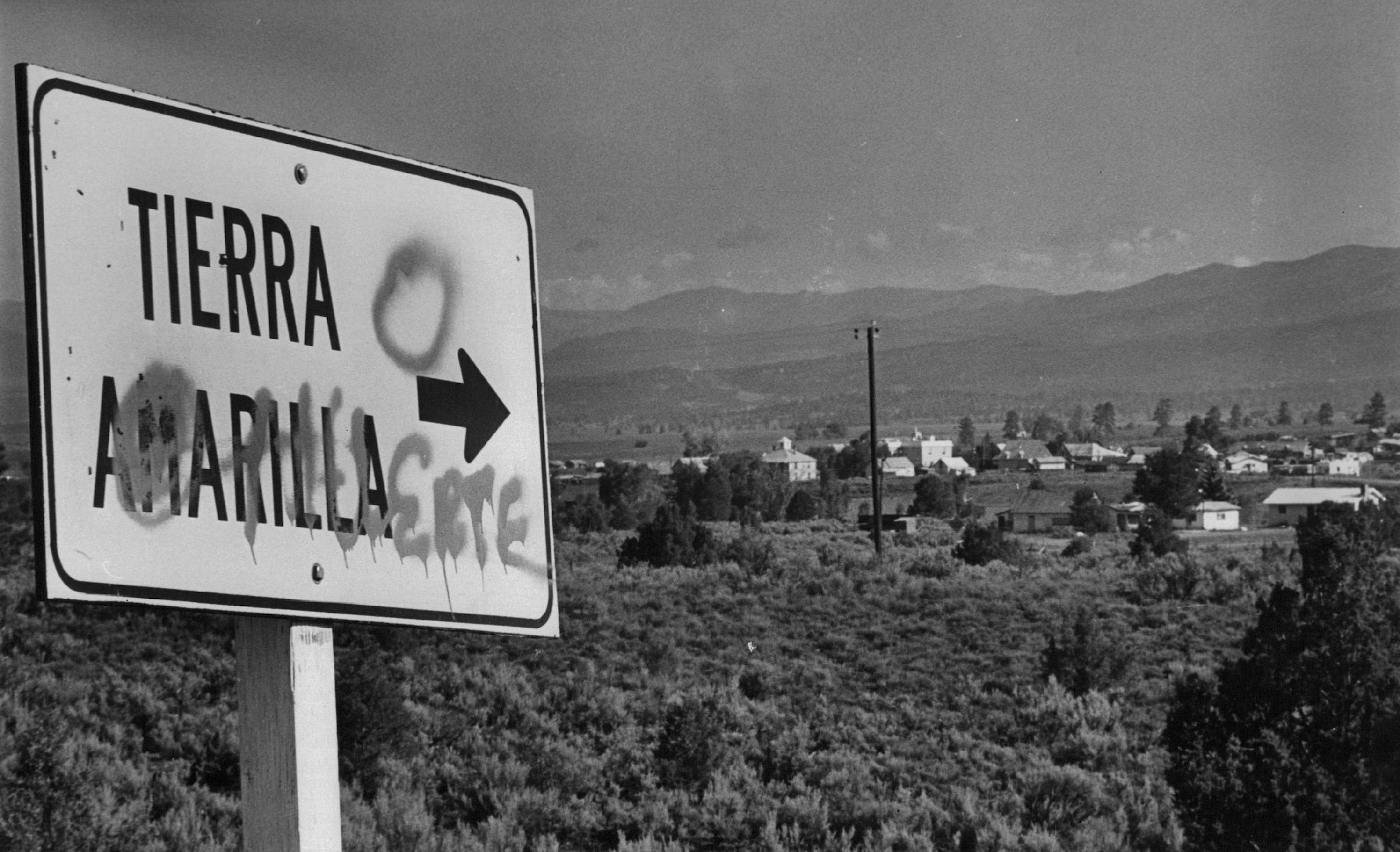 The road sign marking Tierra Amarilla, N.M., has been changed to read Tierra O Muerte, land or death, in the continuing land grant struggle. 1976.