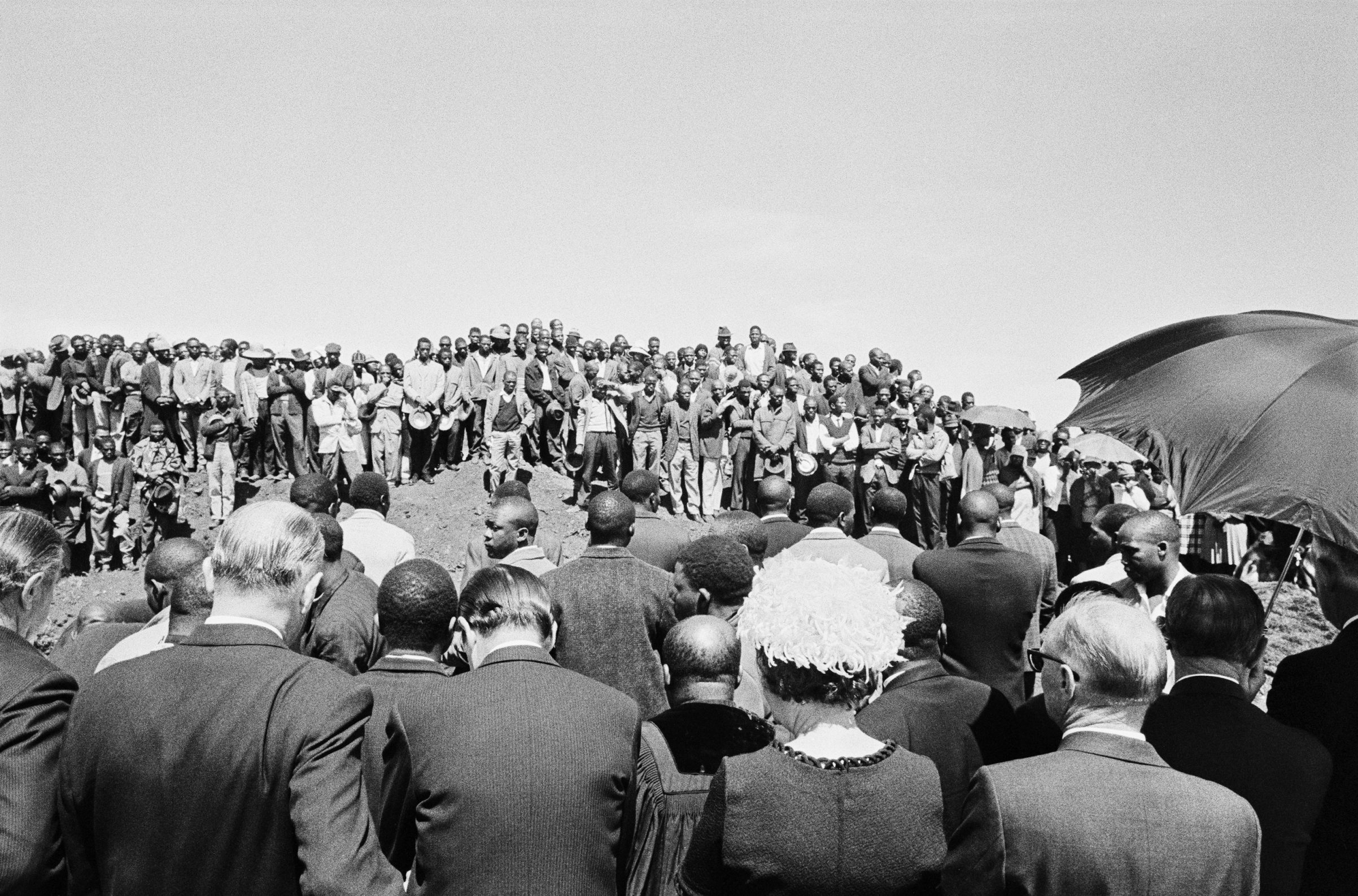 Funeral of 58 Basotho shaftsinkers, killed underground while charging up during the sinking of a new shaft. Buffelsfontein, November 1969