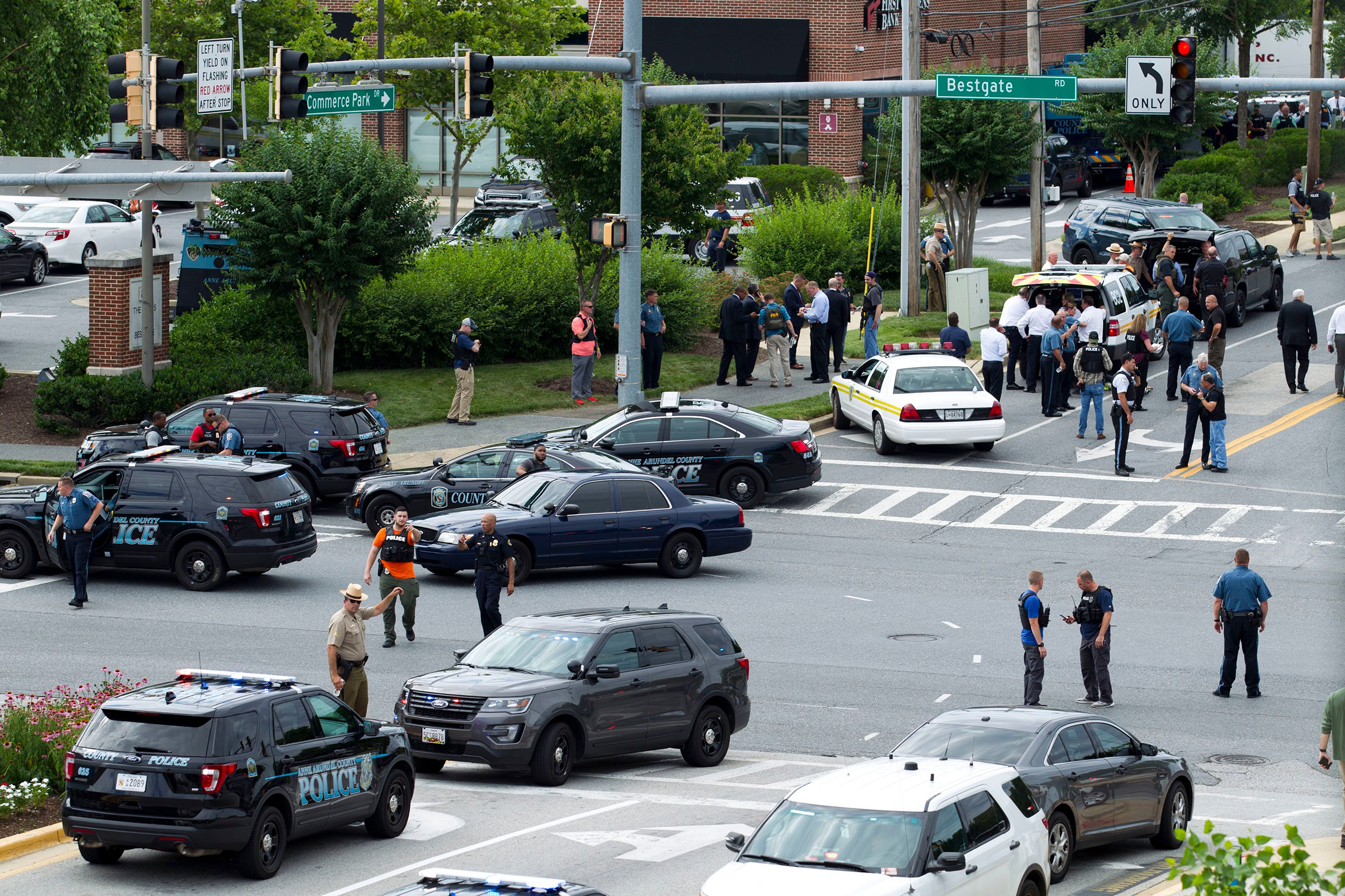 Maryland police officers block the intersection at the building entrance, after multiple people were shot at a newspaper in Annapolis, Md on June 28, 2018.