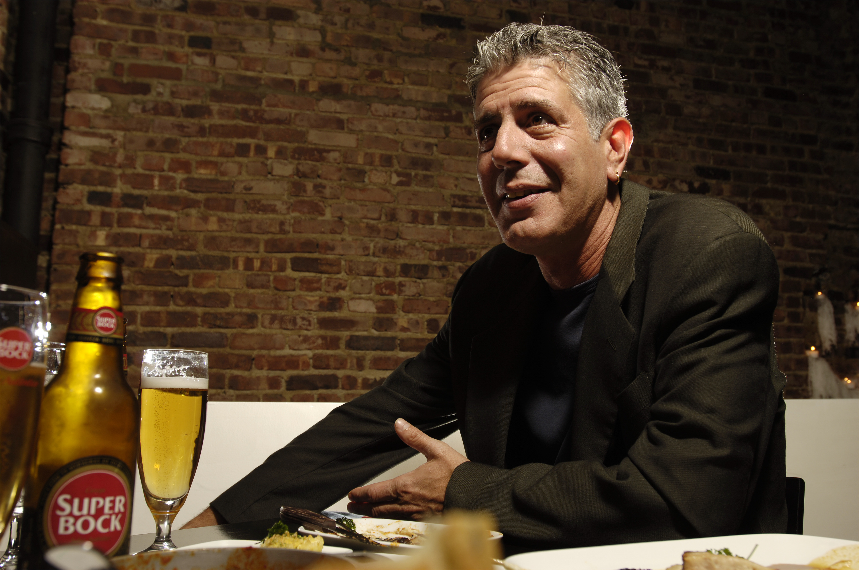 Chef Anthony Bourdain has a drink at Tintol restaurant in Times Square. Bourdain, 49, is the star of  Anthony Bourdain: No Reservations,  the Travel Channel series that's half travelogue and half food show. Traveling constantly for the show, on which he regularly grosses viewers out by eating such delicacies as fermented shark meat in Iceland -  the smell alone would stop a rhinoceros in its tracks,  he says - means he's only in his Manhattan apartment a few days out of the month.  (Photo by James Keivom/NY Daily News Archive via Getty Images)