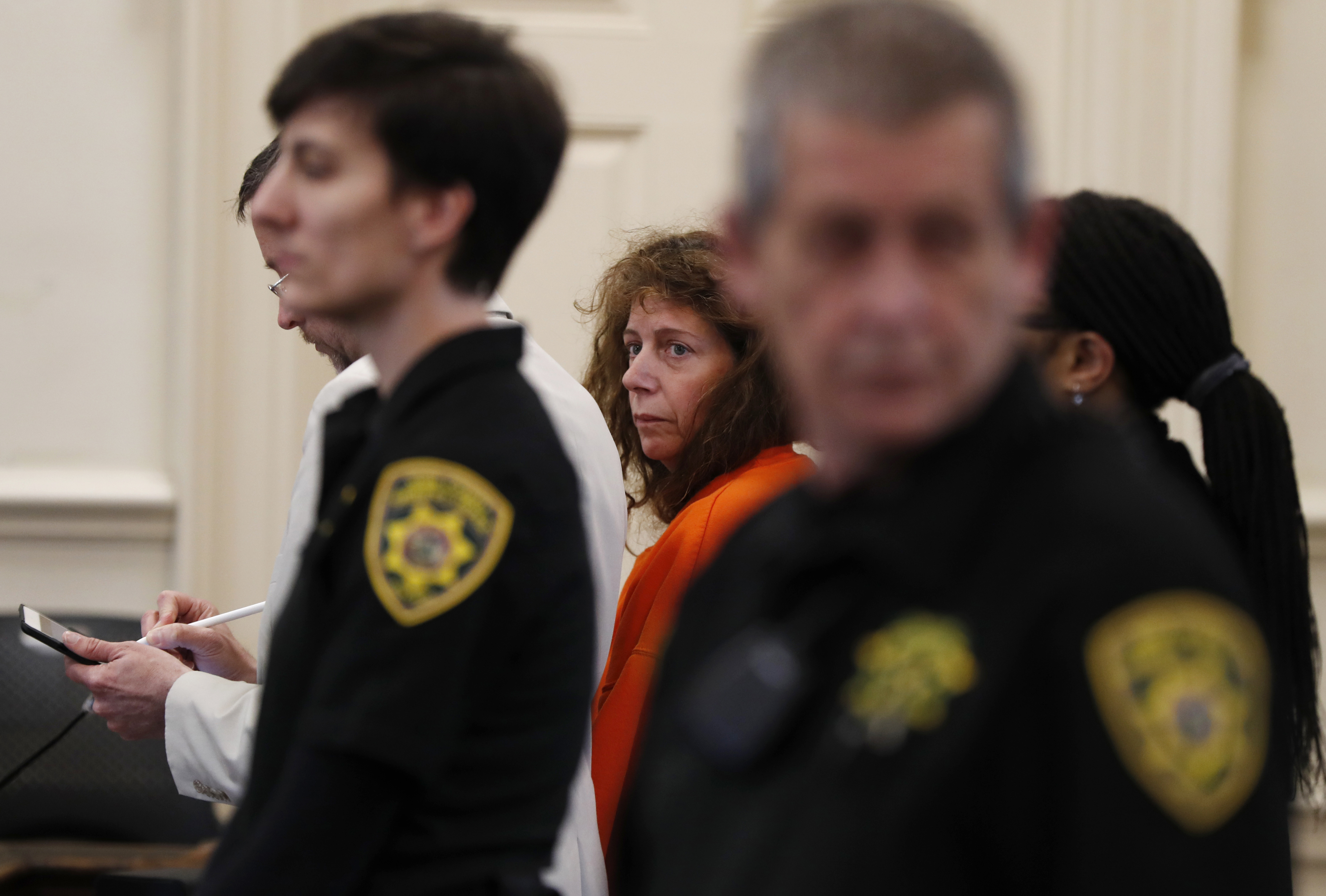 Carol Sharrow, of Sanford, Maine, stands for her arraignment on manslaughter charges at the York County Superior Court in Alfred, Maine on June 4, 2018.
