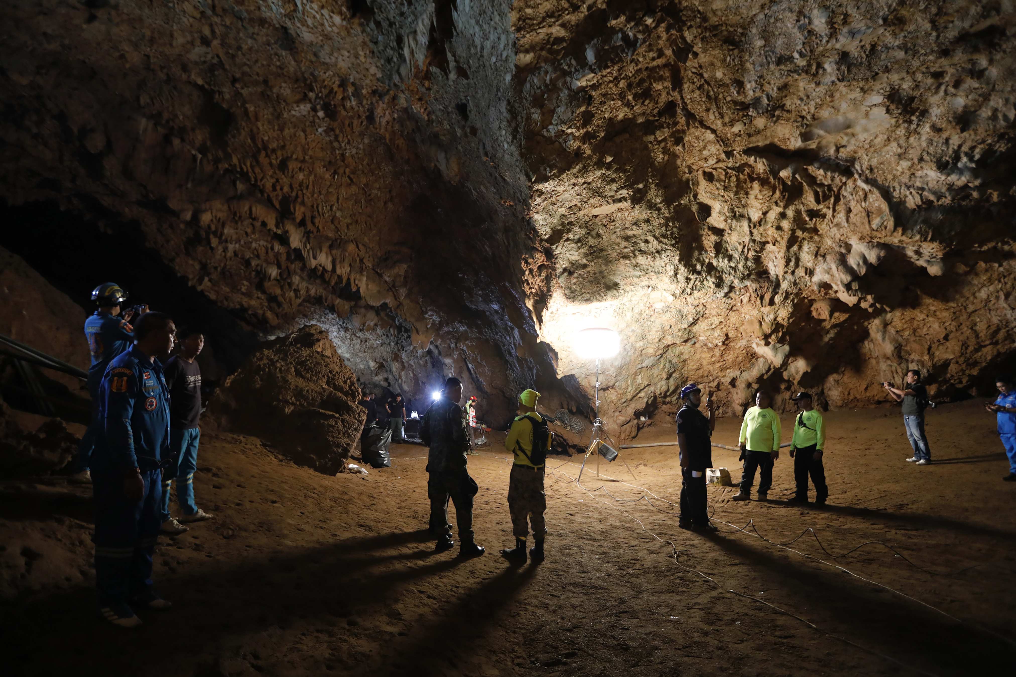 Rescue teams gather in a deep cave where a group of boys went missing in Chang Rai, Thailand on June 25, 2018.