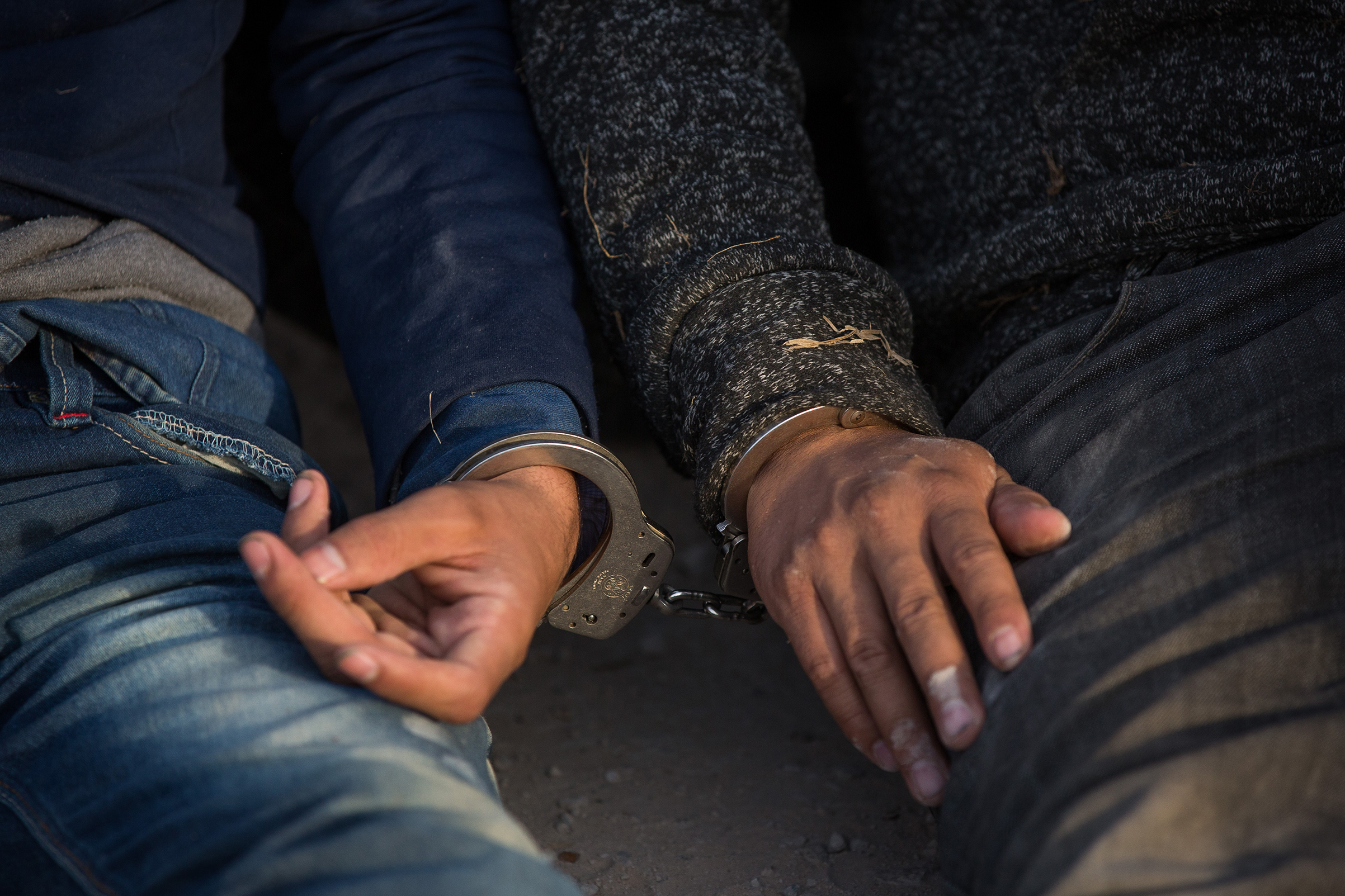 After being apprehended by Border Patrol, illegal immigrants wait to be transported to a central processing center shortly after they crossed the border from Mexico into the United States on Monday, March 26, 2018 in the Rio Grande Valley Sector near McAllen, Texas. - An estimated 11 million undocumented immigrants live in the United States, many of them Mexicans or from other Latin American countries.