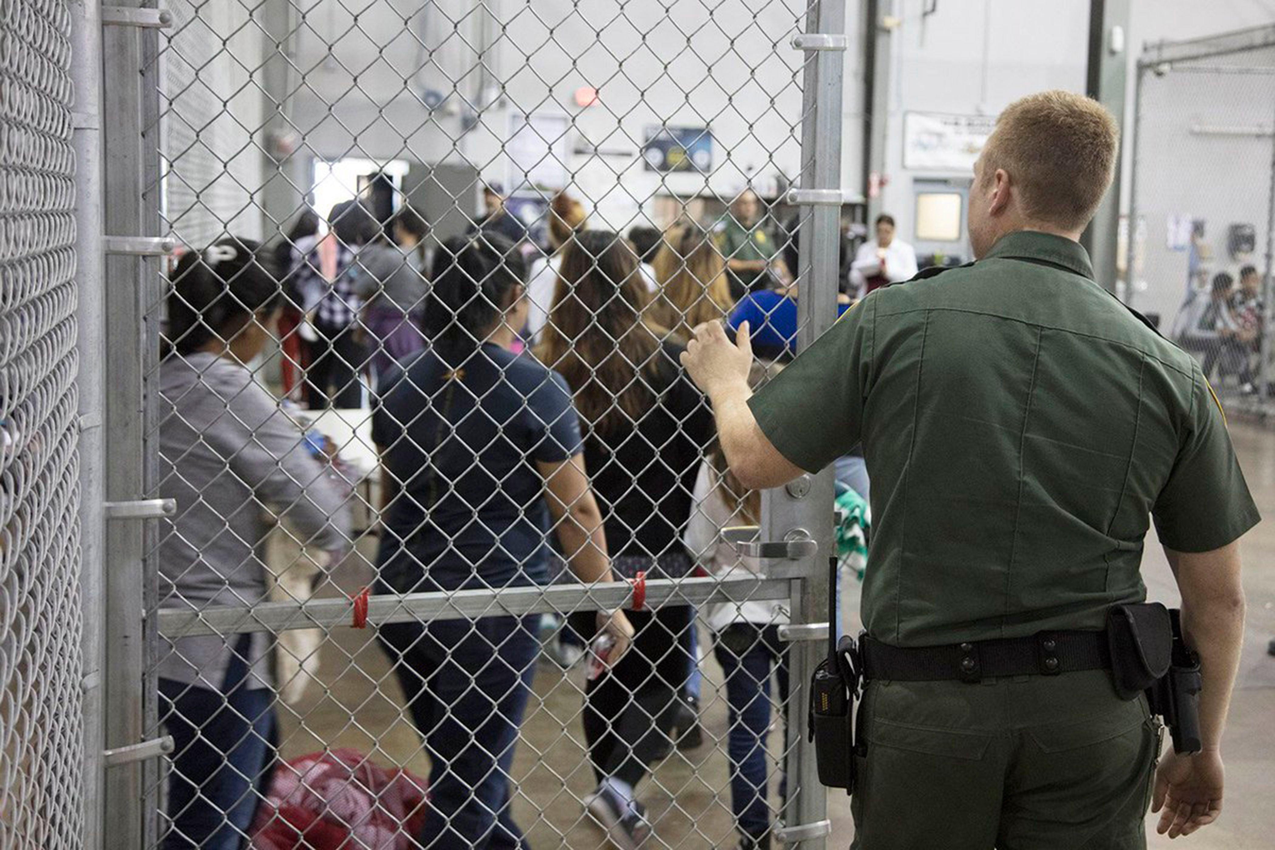 An undated handout photo made available on 18 June 2018 by the US Customs and Border Patrol showing people inside a United States Border Patrol Processing Center, in McAllen, Texas