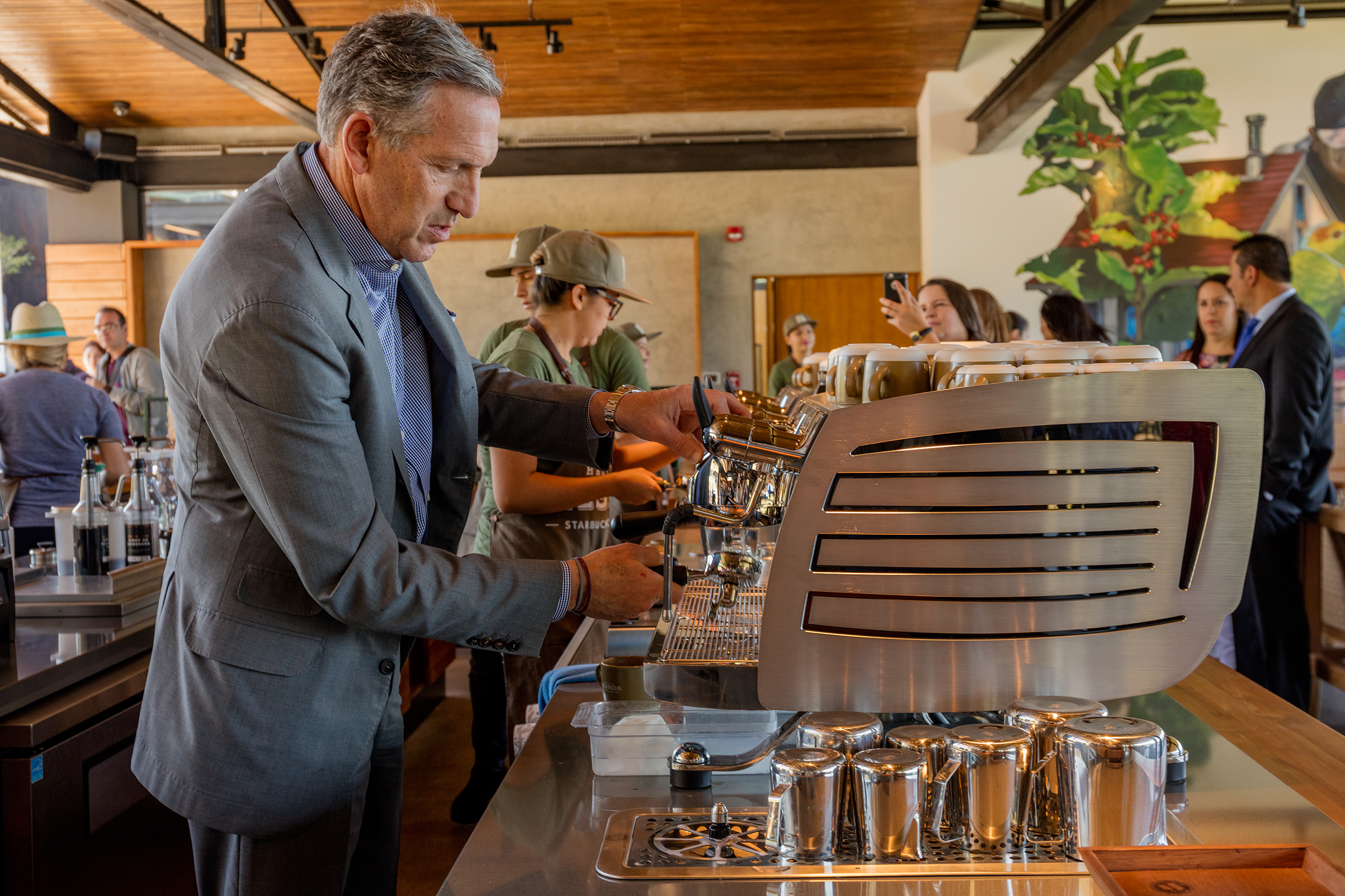 Longtime Starbucks boss Howard Schultz brews a cup of coffee at the company's Costa Rican coffee farm