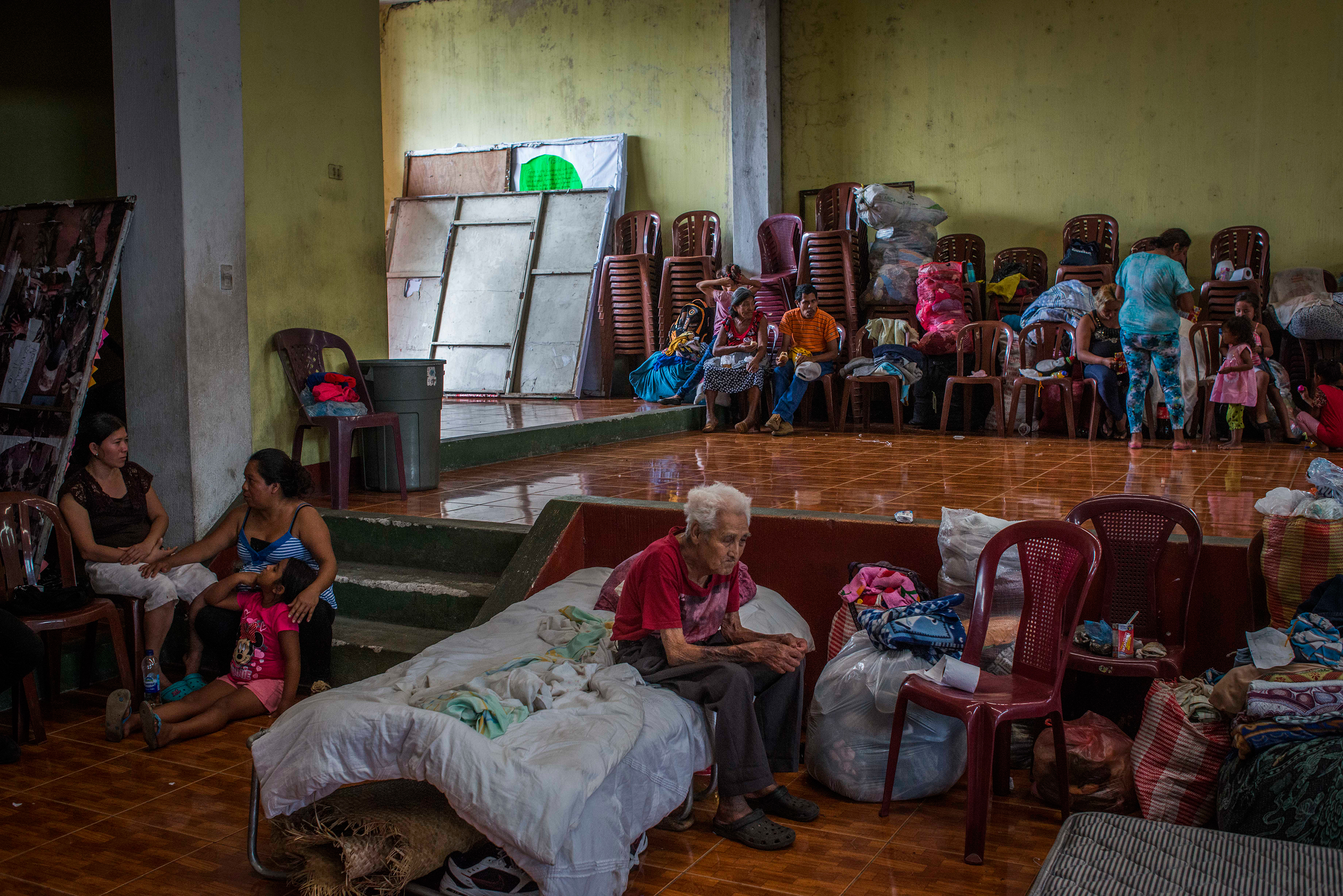 Residents of San Miguel Los Lotes rest in a shelter in Escuintla, a nearby city, on June 4.