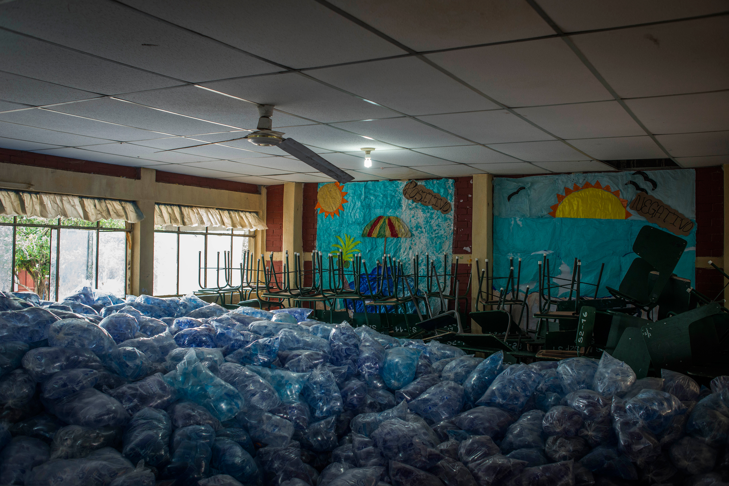 Packages of water fill a room at a shelter in Escuintla on June 4.