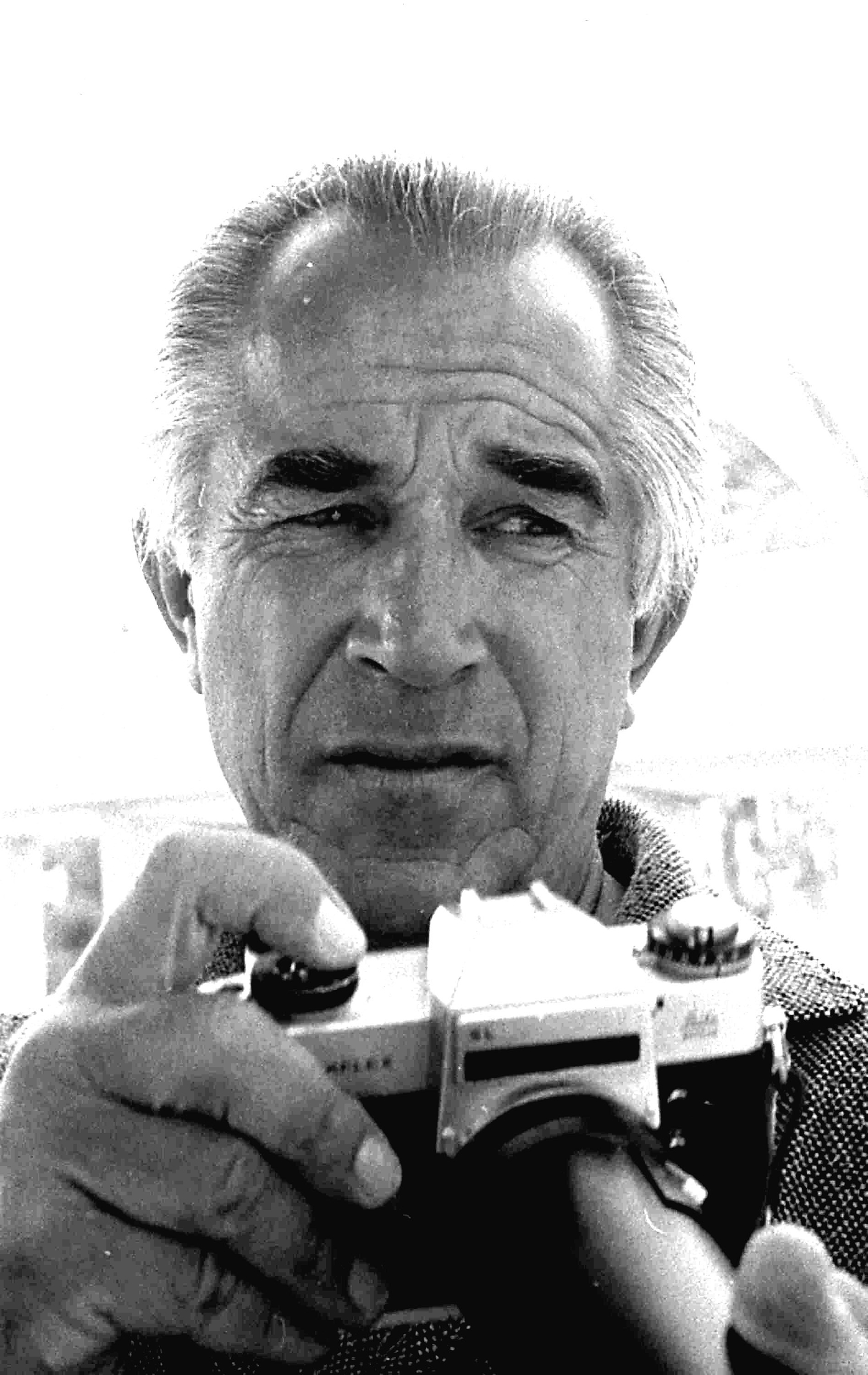 Headshot portrait of American photographer David Douglas Duncan as he holds a camera, Miami, Florida, April 1969.