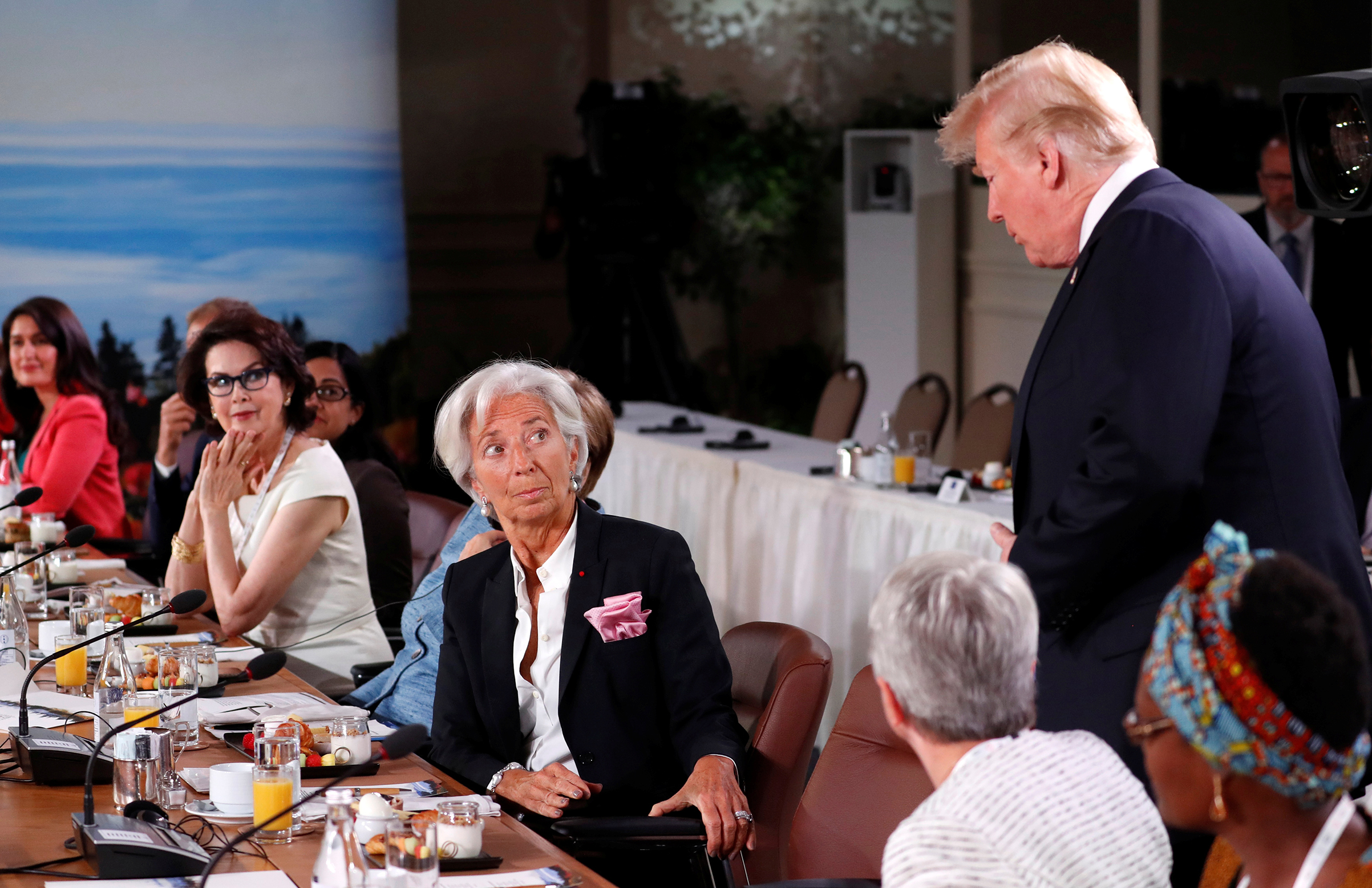 President Trump arrives as Managing Director of the International Monetary Fund, Christine Lagarde, looks up while they attend a G7 and Gender Equality Advisory Council meeting as part of the summit in Canada on June 9, 2018.