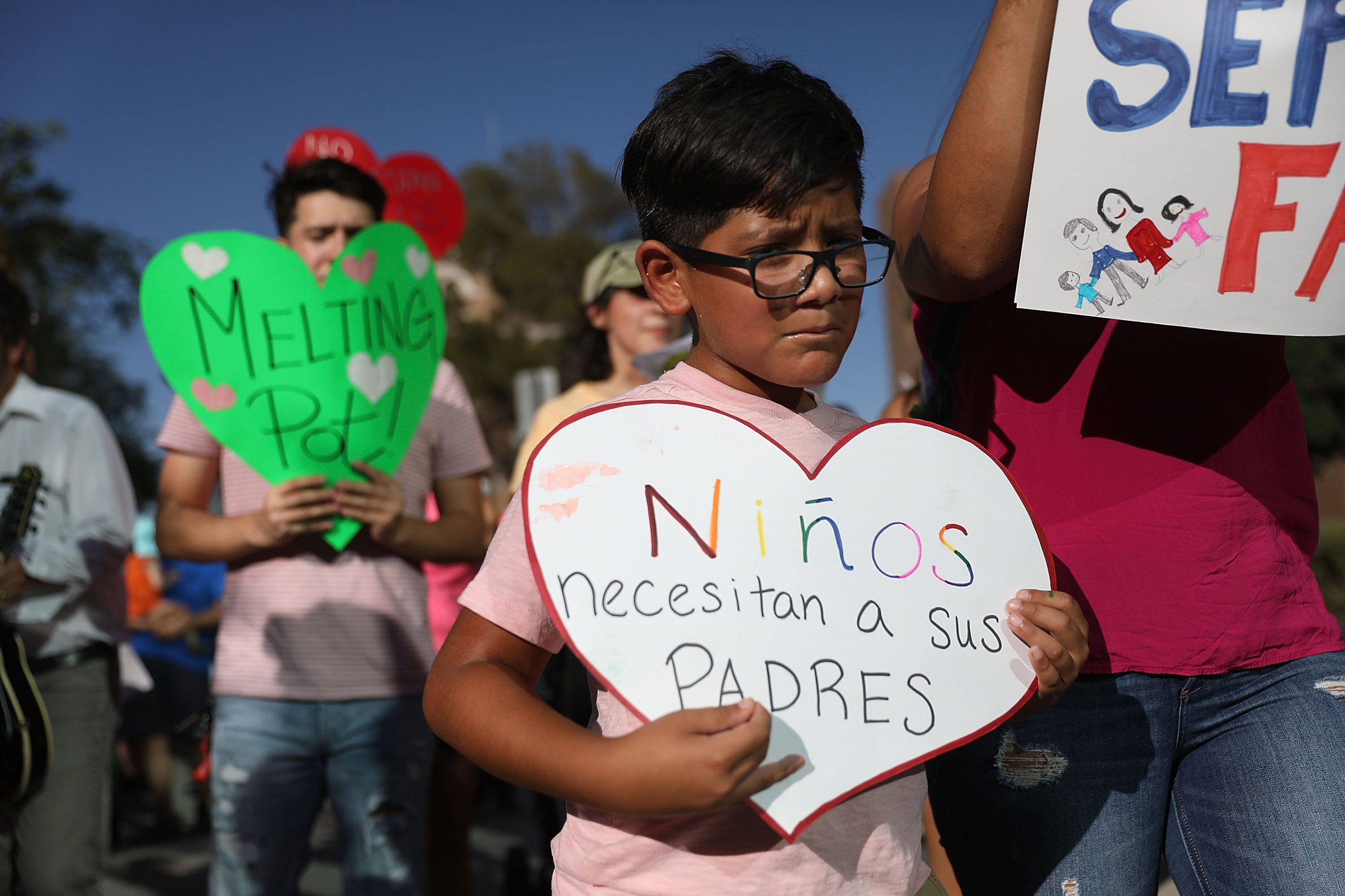 Protesters walk though the streets as they protest against the Trump administration's immigration policies on June 21, 2018 in El Paso, Texas.