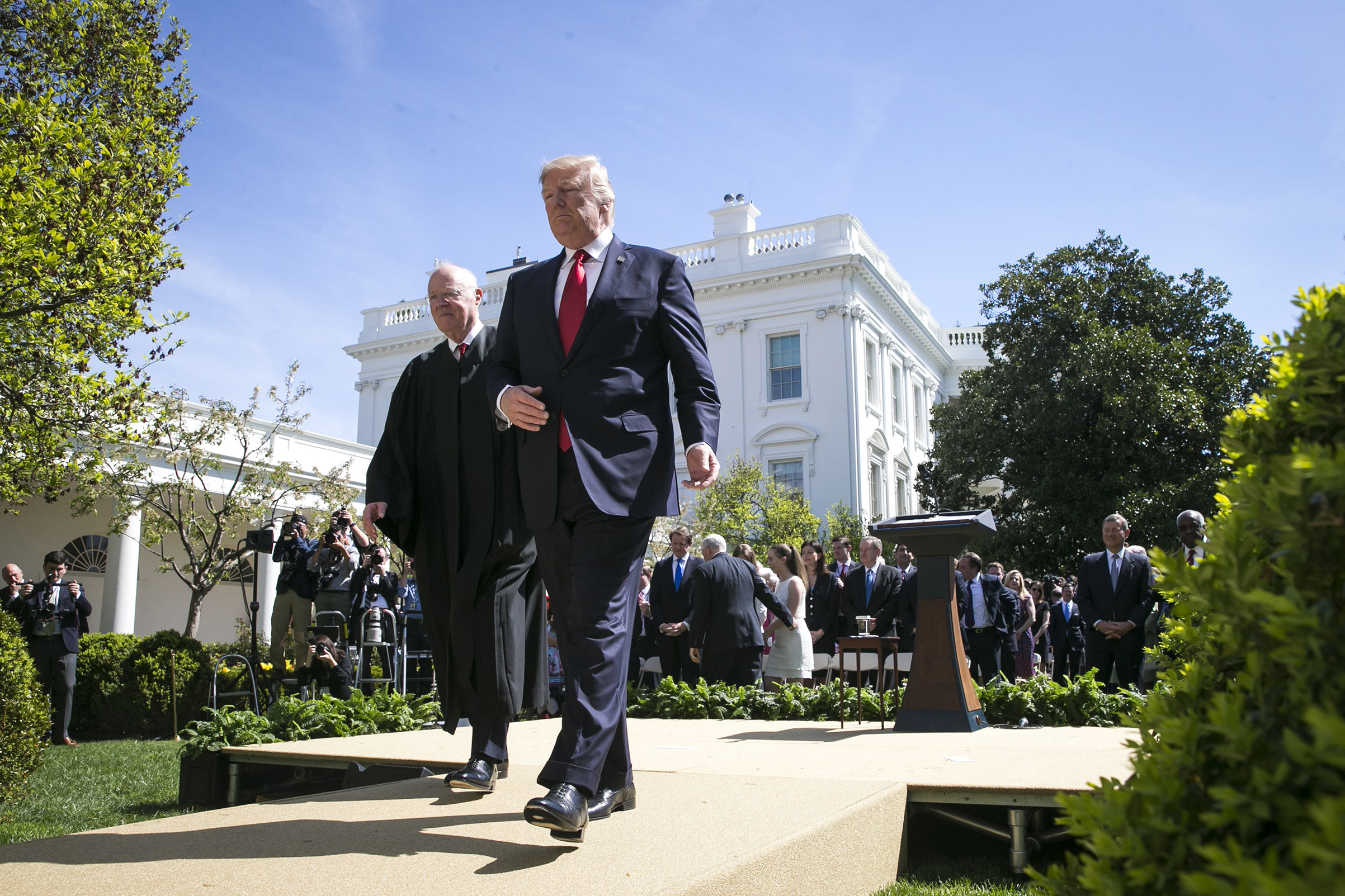 Anthony Kennedy leaves the Rose Garden with President Donald Trump April 10, 2017, after swearing in Neil Gorsuch as the 113th Supreme Court Justice.