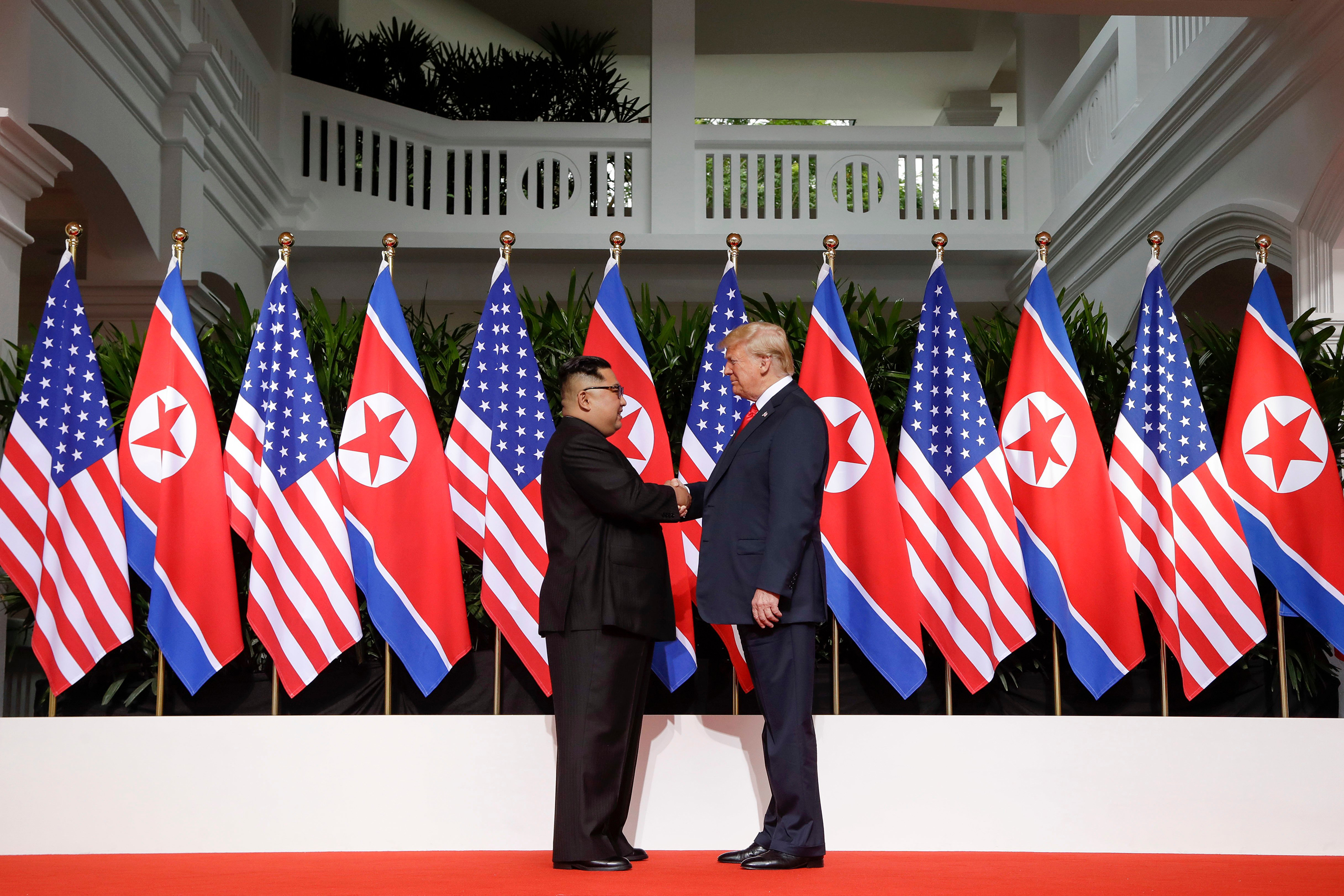 President Trump and North Korea's Kim Jong Un shake hands at their historic summit in Singapore on June 12, 2018.