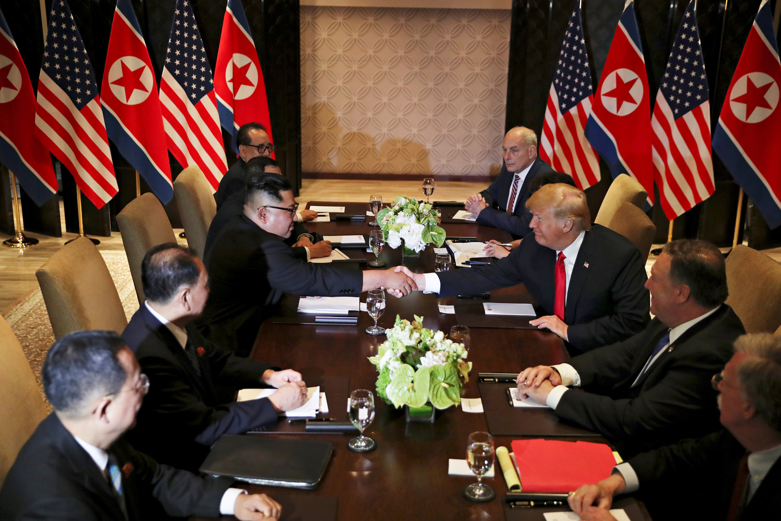 President Trump shakes hands with North Korea's Kim Jong Un before their expanded bilateral meeting in Singapore on June 12, 2018.