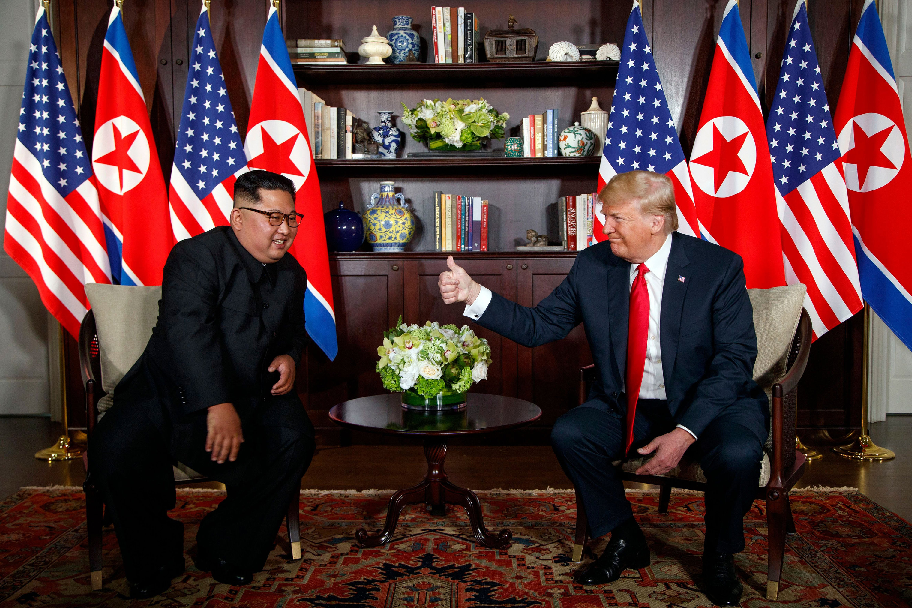 President Trump gives Kim a thumbs up during their historic summit in Singapore on June 12, 2018.