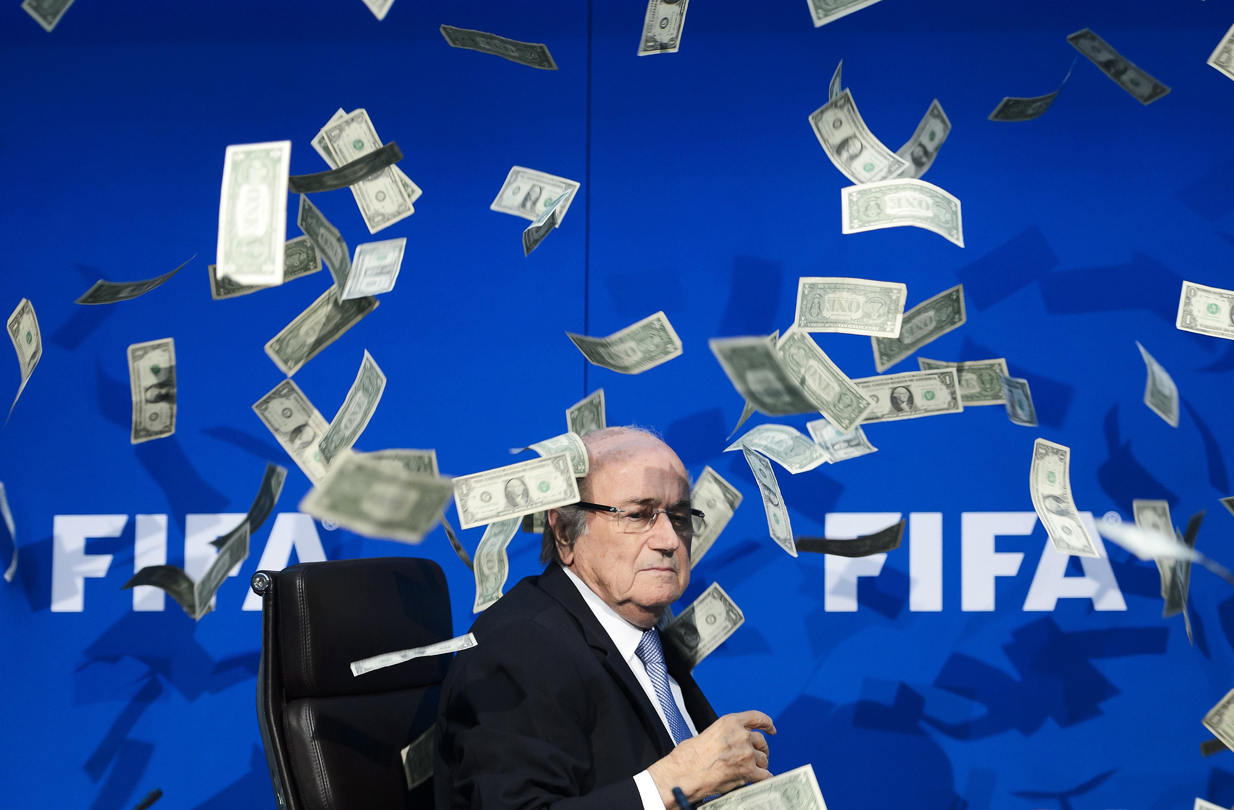 Then FIFA president Blatter endures a flurry of fake bills thrown by a comedian on July 20, 2015