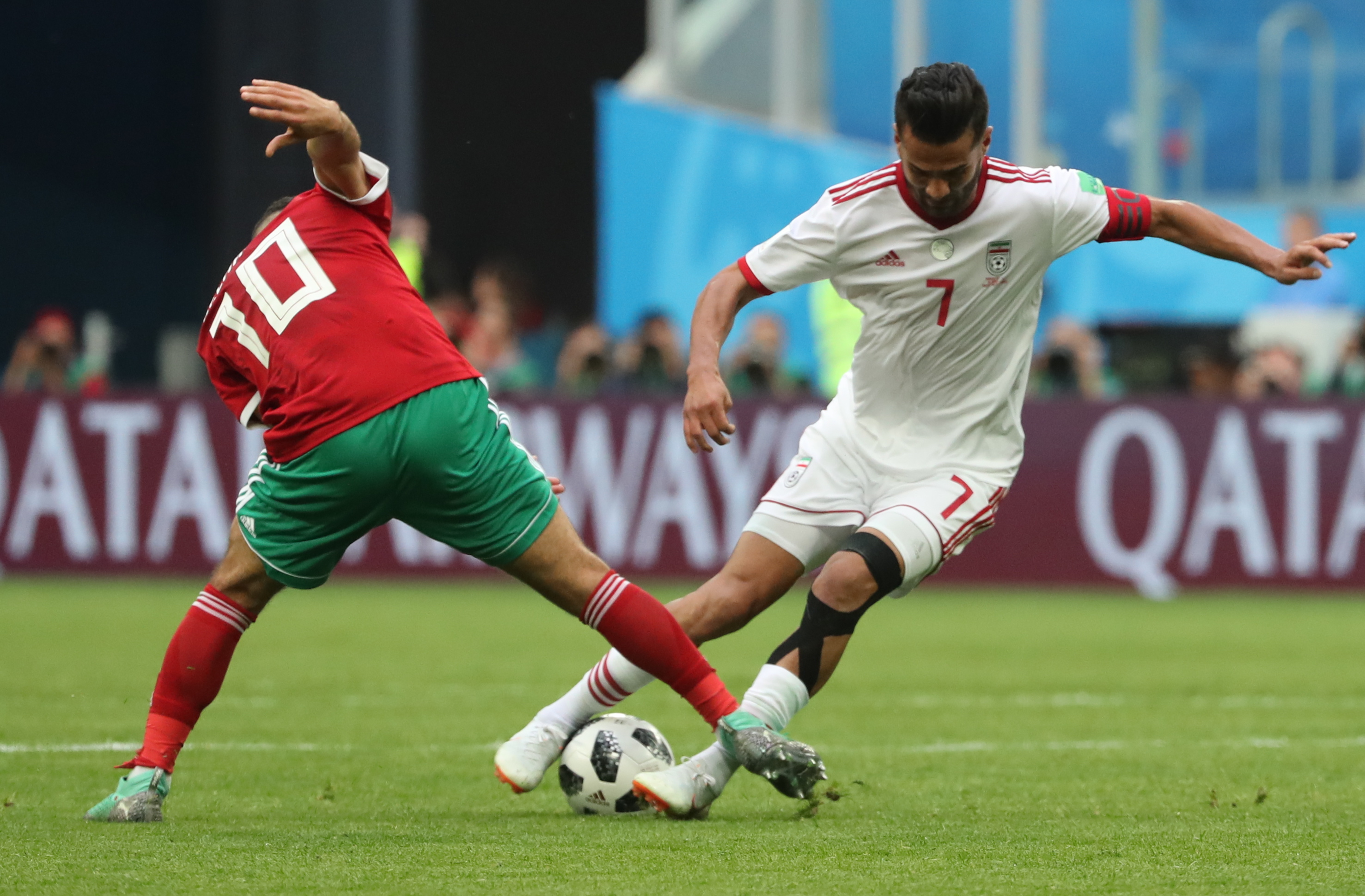 ST PETERSBURG, RUSSIA - JUNE 15, 2018: Morocco's Younes Belhanda (L) and Iran's Masoud Shojaei in a First Stage Group B football match between Morocco and Iran at Saint-Petersburg Stadium (also known as Krestovsky Stadium) at FIFA World Cup Russia 2018