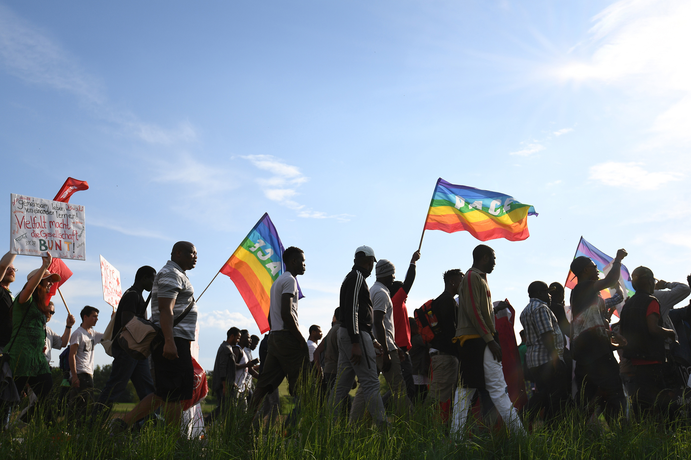 Refugees and activists march in the German town of Ellwangen on May 9
