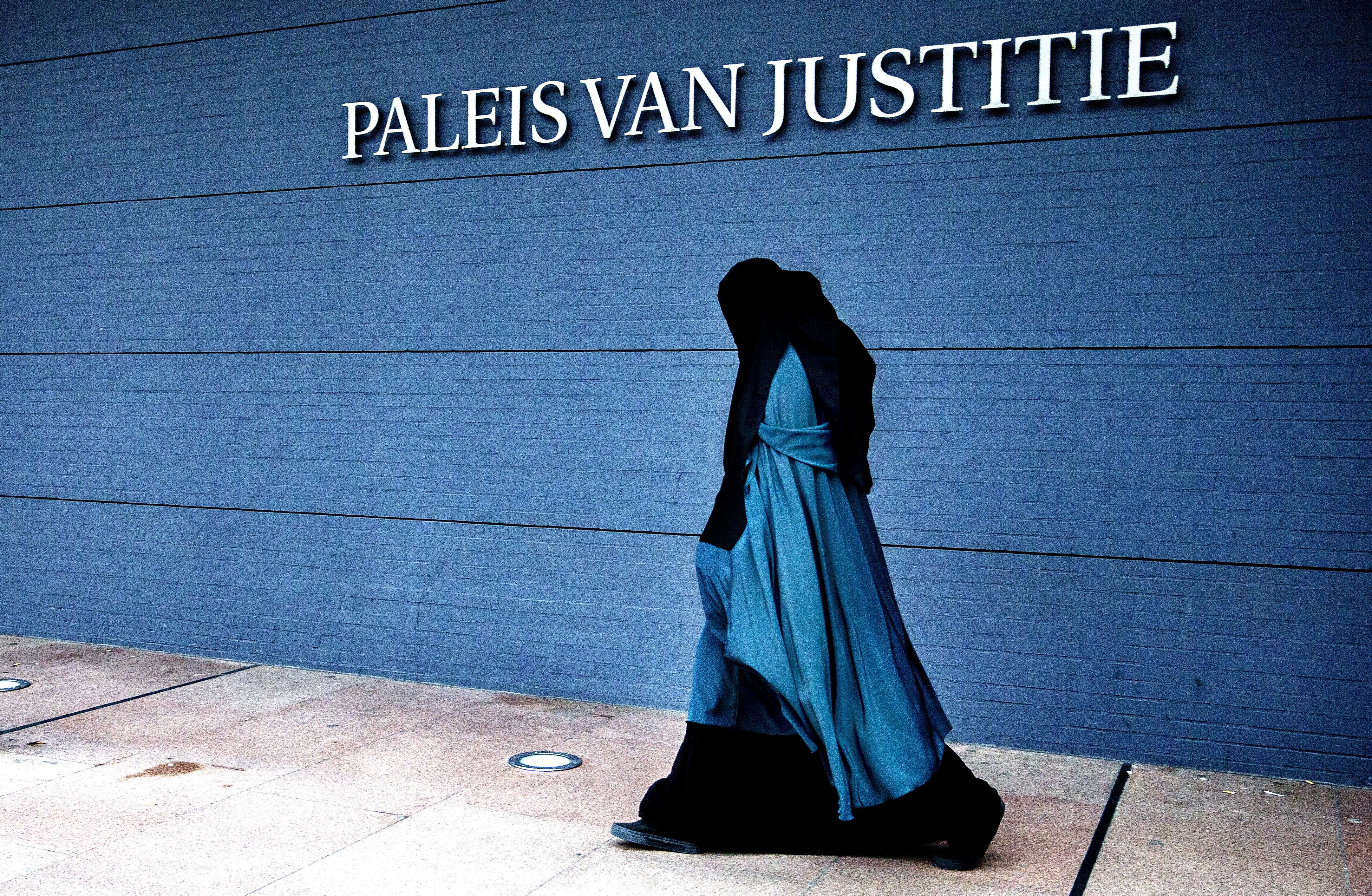 A woman wearing a burqa walks past the Palace of Justice in The Hague on Dec. 1, 2014.