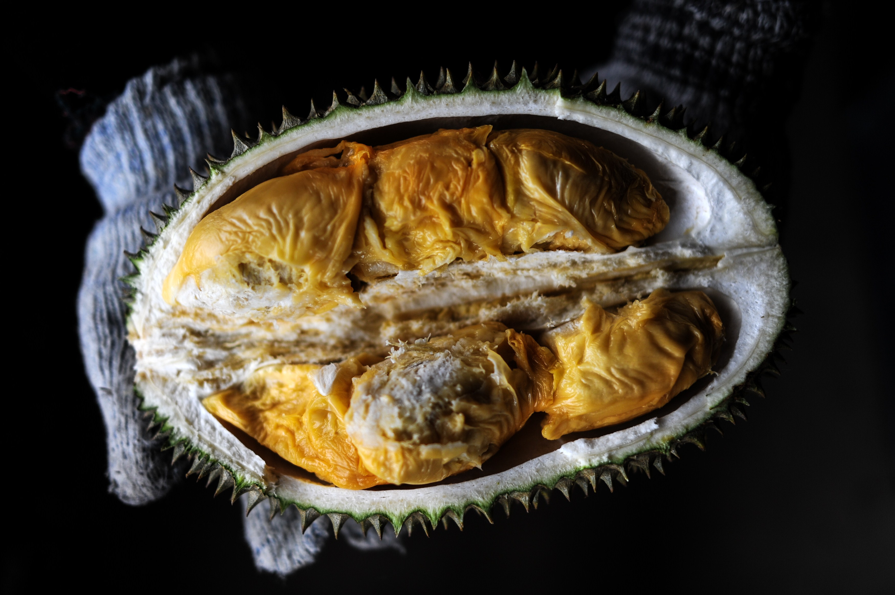 A vendor displays the cross section of a durian fruit in the suburbs outside Kuala Lumpur on July 14, 2015.