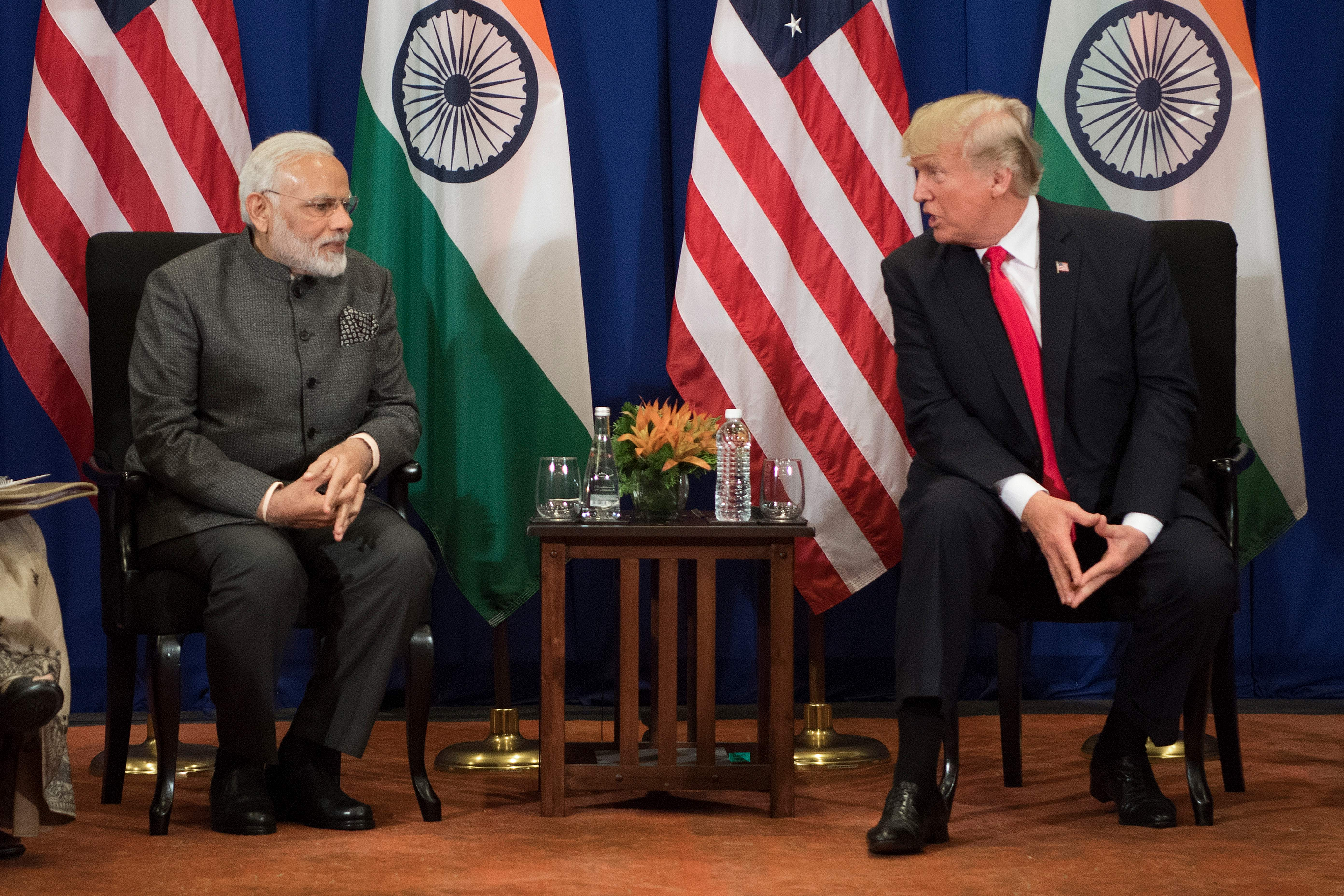 US President Donald Trump (R) speaks with Indian Prime Minister Narendra Modi during a bilateral meeting on the sideline of the 31st Association of Southeast Asian Nations (ASEAN) Summit in Manila on November 13, 2017.