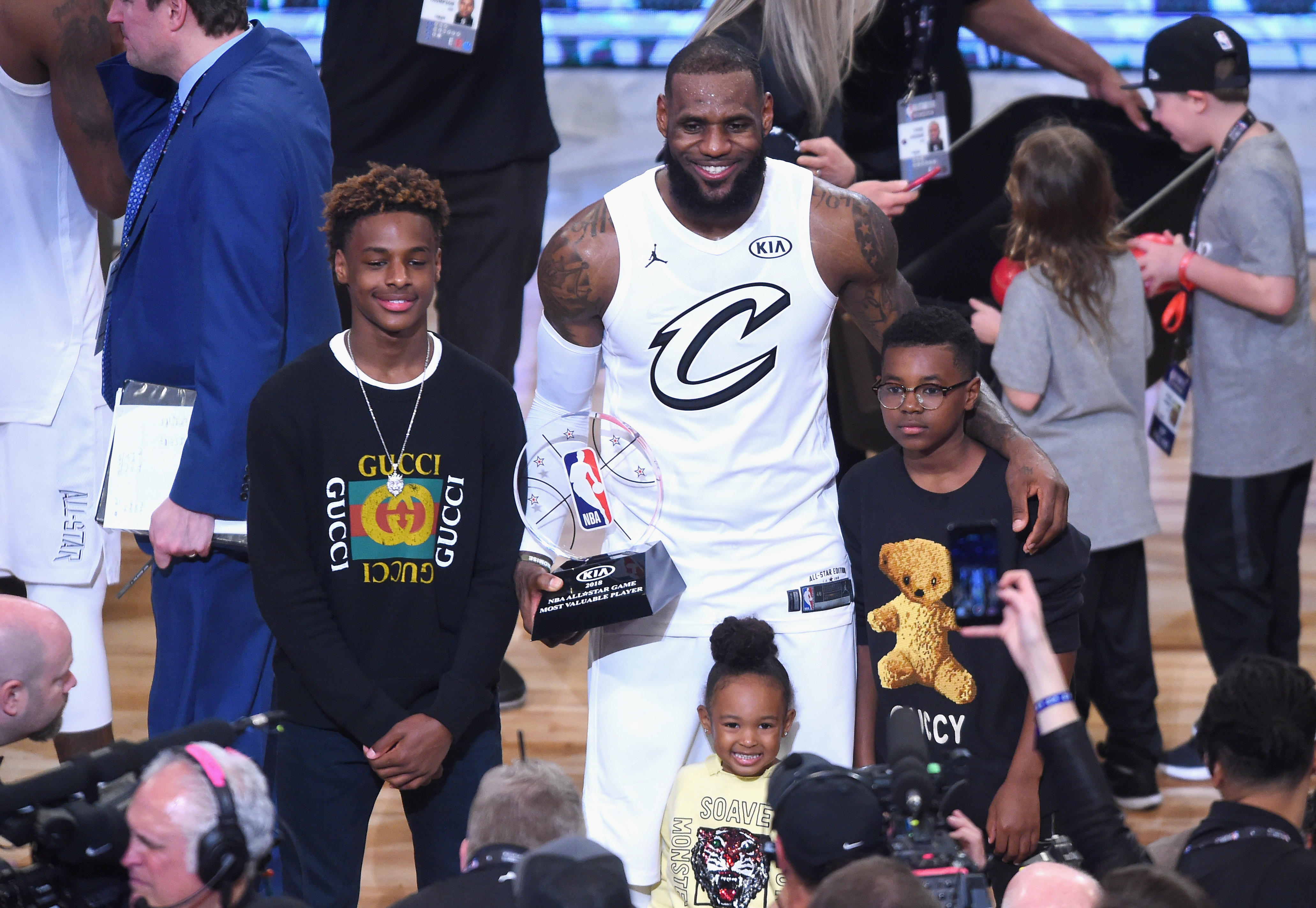 LOS ANGELES, CA - FEBRUARY 18:  (L-R) LeBron James Jr., LeBron James #23, Zhuri James and Bryce Maximus James pose for a photo with the All-Star Game MVP trophy during the NBA All-Star Game 2018 at Staples Center on February 18, 2018 in Los Angeles, California.  (Photo by Jayne Kamin-Oncea/Getty Images)