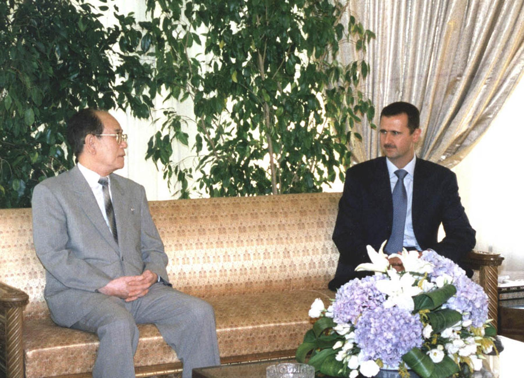 Syrian President Bashar Assad meets with North Korea's second leader, Kim Yong-Nam, in Damascus at the end of the latter's three-day visit to Syria 18 July 2002.