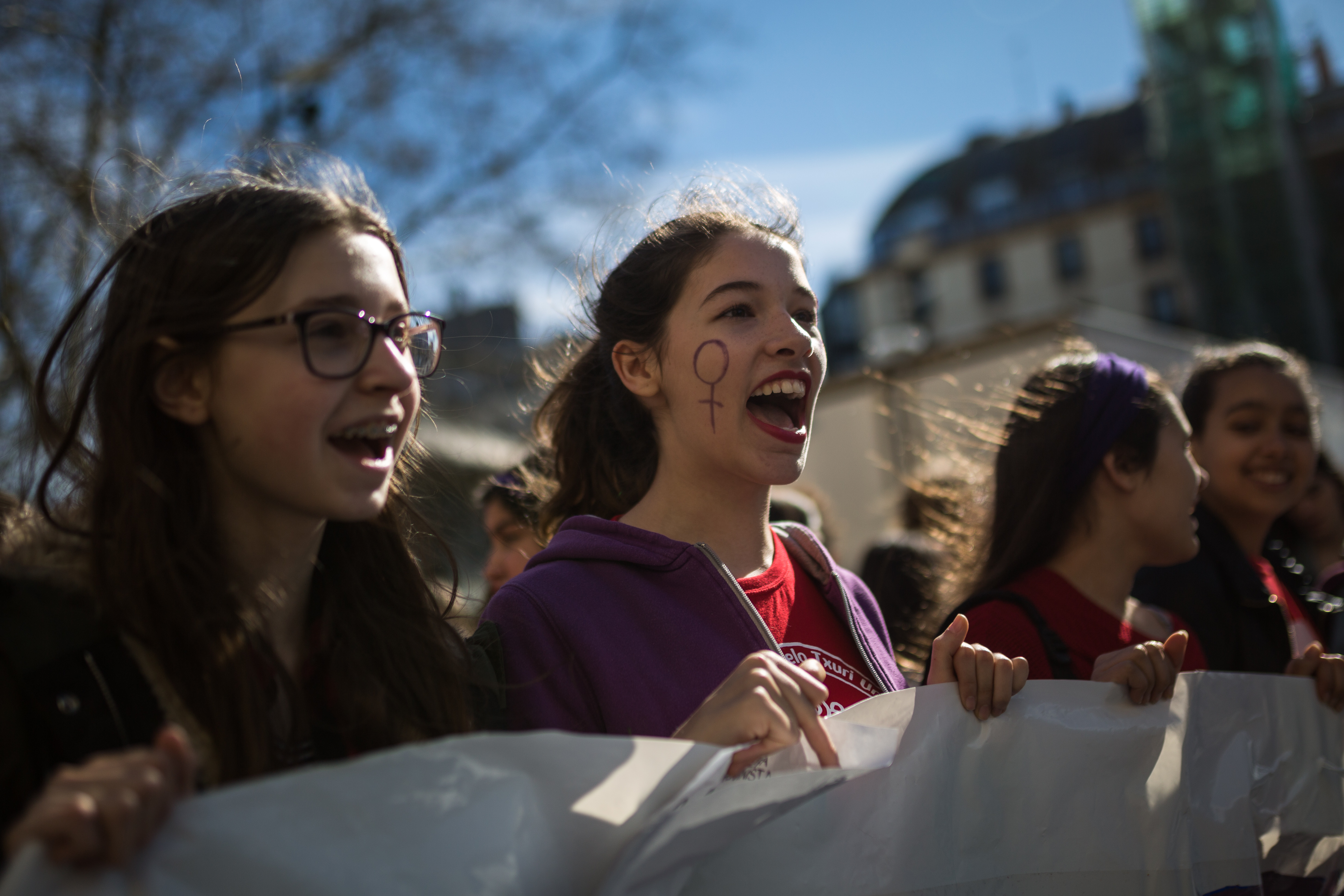 Several students carry a banner during demonstrations of the feminist general strike in the streets of San Sebastian on March 8, 2018.